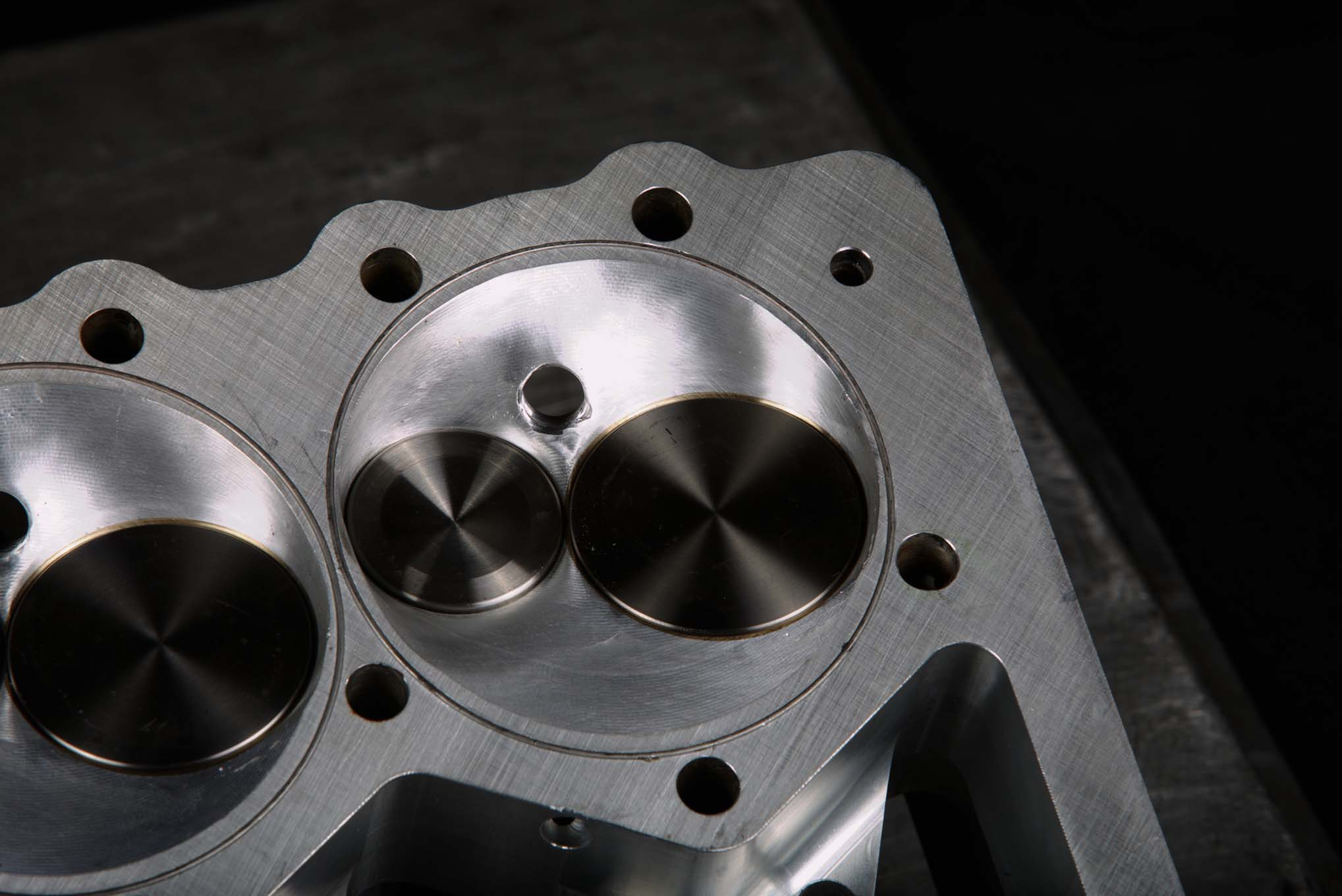 The Alan Johnson billet heads feature intake-exhaust, intake-exhaust, intake-exhaust, intake-exhaust valve arrangement, which cuts down on heat generated by the siamesed exhaust ports in a production Chevy small-block head. The previous head with symmetric valve arrangement was causing dropped valves with ever-increasing frequency.