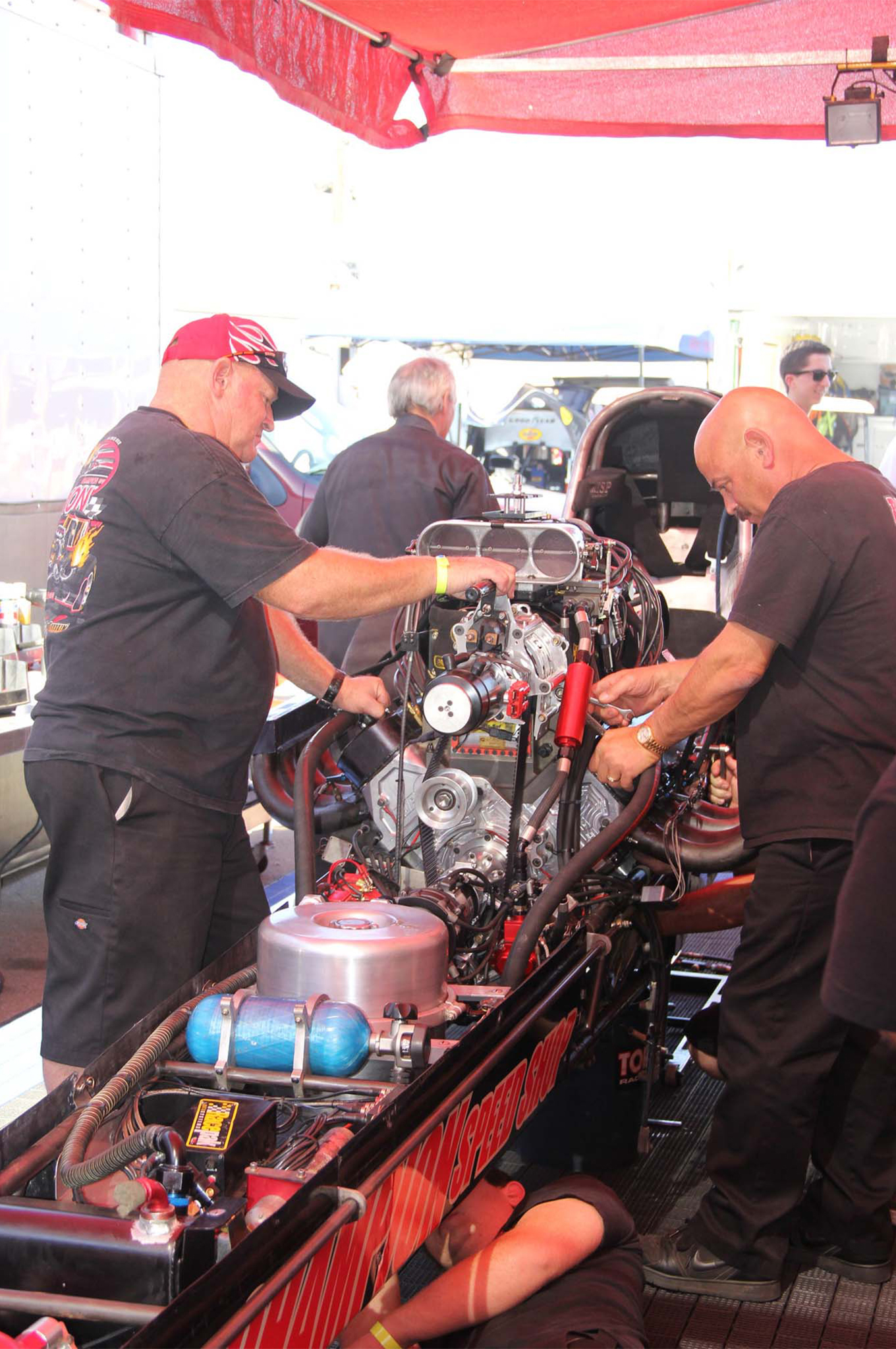 Tom Mclennan on the left and Tony Bernardini wrenching on the Special at Bakersfield.