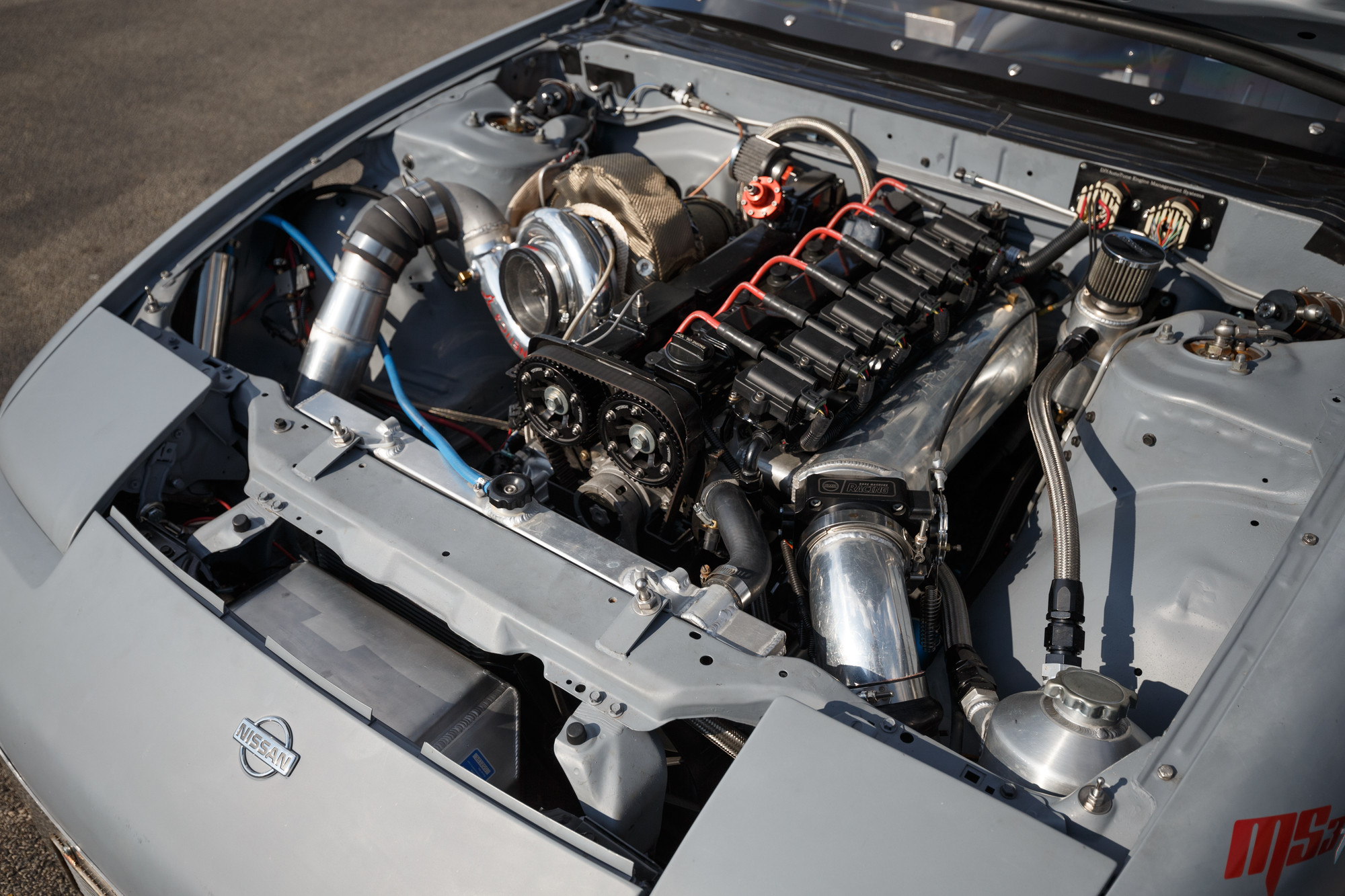 The Toyota 2JZ GTE is a 3.0L twin-turbo inline-six originally found in America in 1993–1998 Toyota Supras. Now the boosted six sends power to a G-Force GF4A transmission and a GM 12-bolt rear axle with 3.73:1 gears.