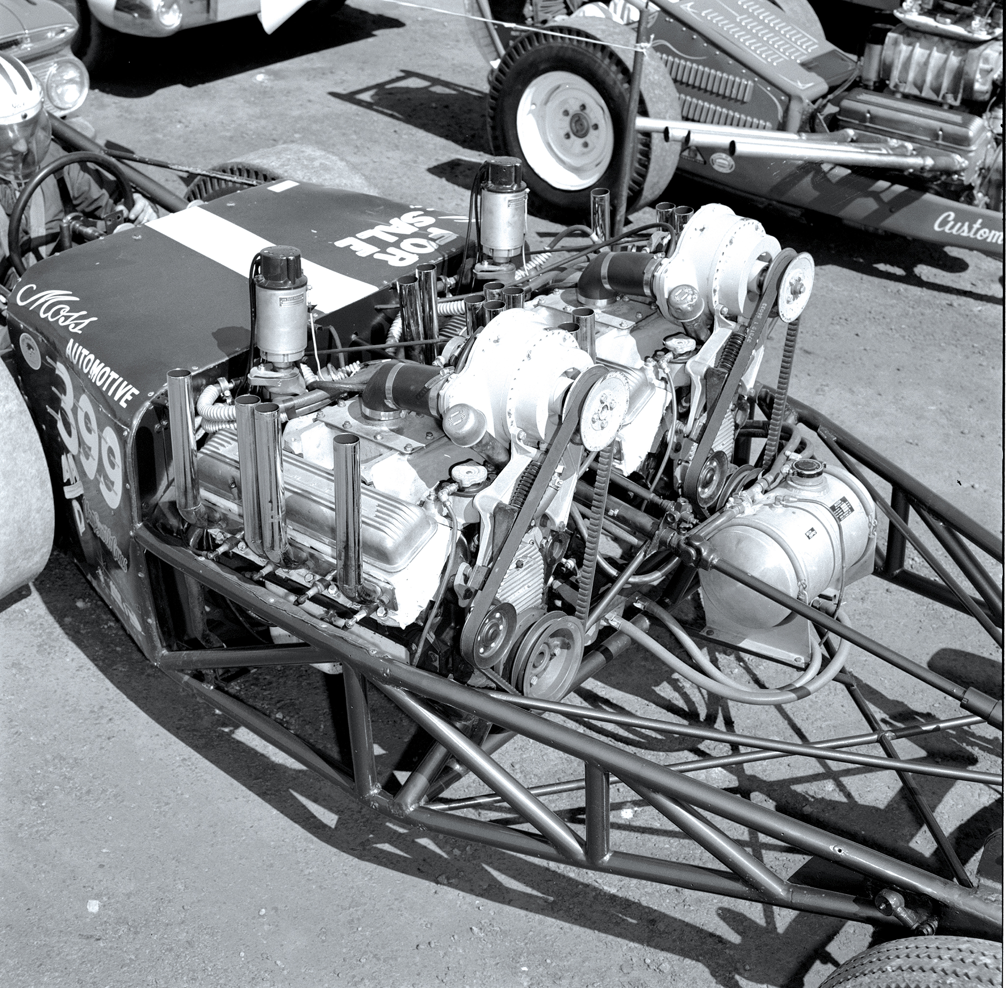 Texan Jack Moss was an opposed-twin-engine terror in the early years and raced at the first NHRA Nationals at Great Bend, Kansas, and got down to four cars. In the early 1960s, he built the twin-engine car shown here. Originally, it had a full streamliner body slightly resembling the Jocko-designed streamliner that Garlits built and raced. He would later change to 6-71 Roots-type blowers, and around 1962, he would build a single-engine gas dragster.
