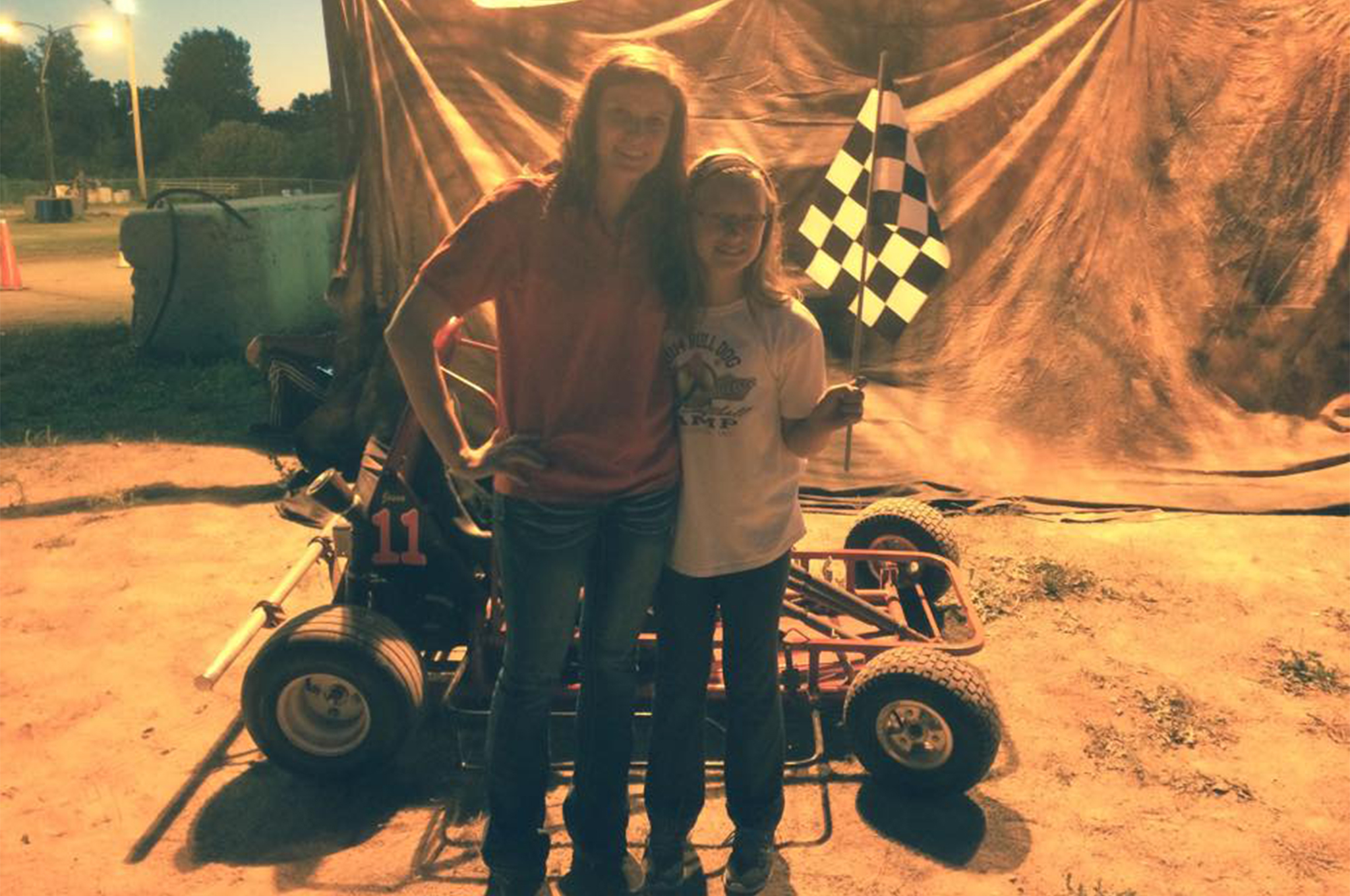 While she points to Alan Kulwicki as one of her role models, Reagan has become one herself—celebrating a victory with this young Oshkosh (Wisconsin) Kids Kart Club racer.