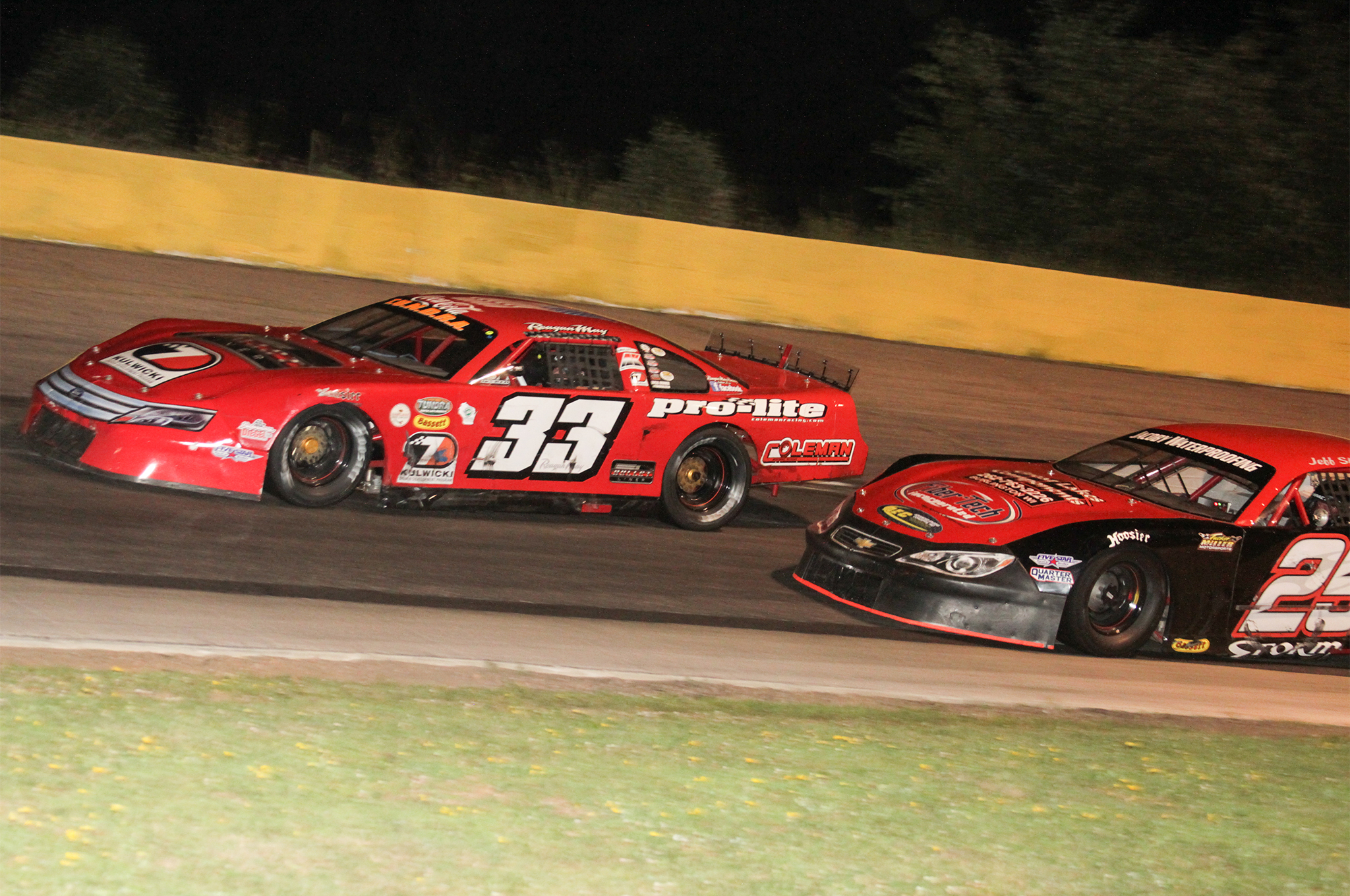 Reagan works the high side around Jeff Strom at State Park Speedway.