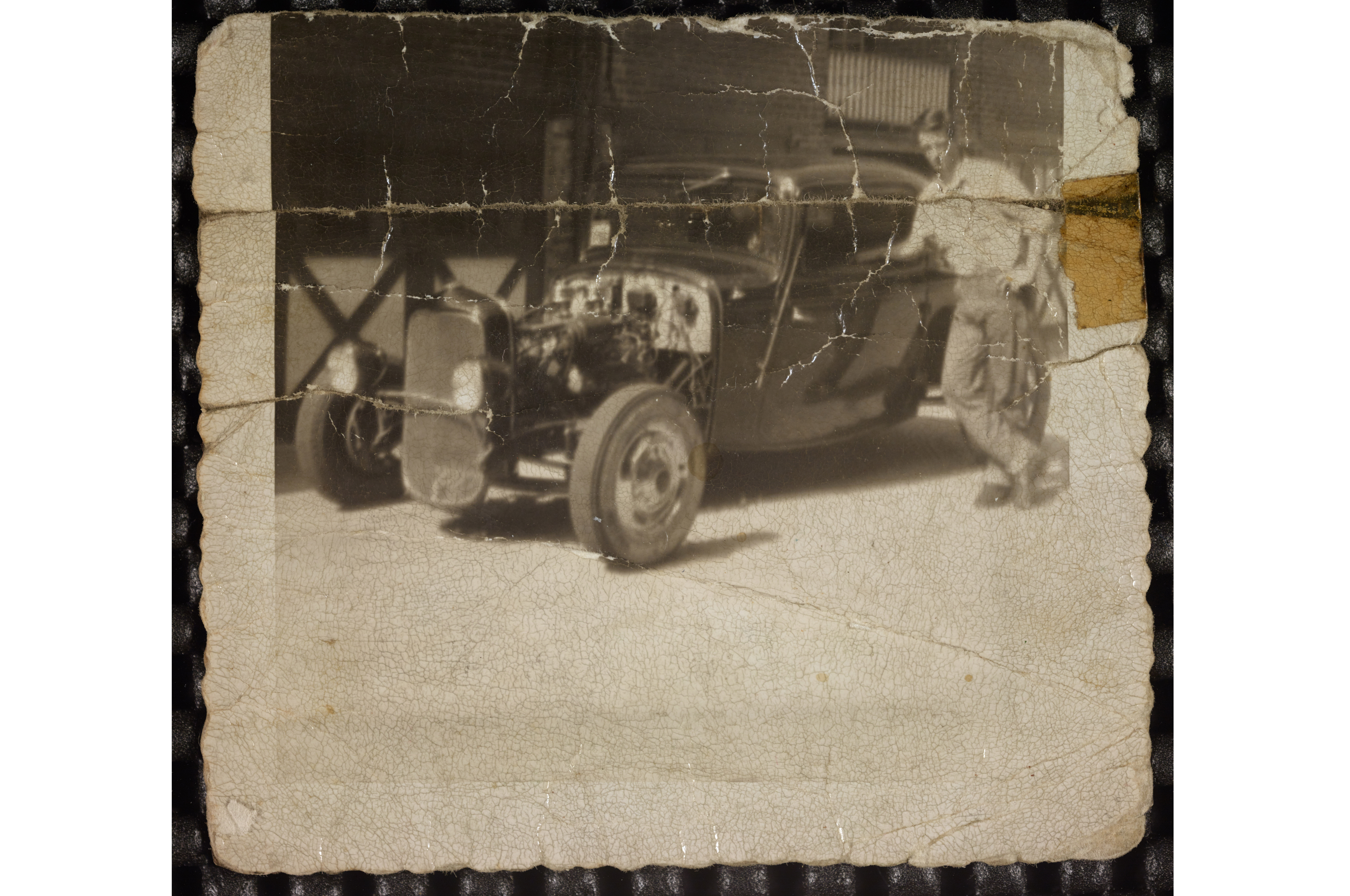 This is the photo of Kelly's coupe that Bob Kasner saw in its 2013 eBay auction. The photo is undated, but the black paint and what looks like a flathead between the framerails would mean it was likely taken in the late '40s or very early '50s.