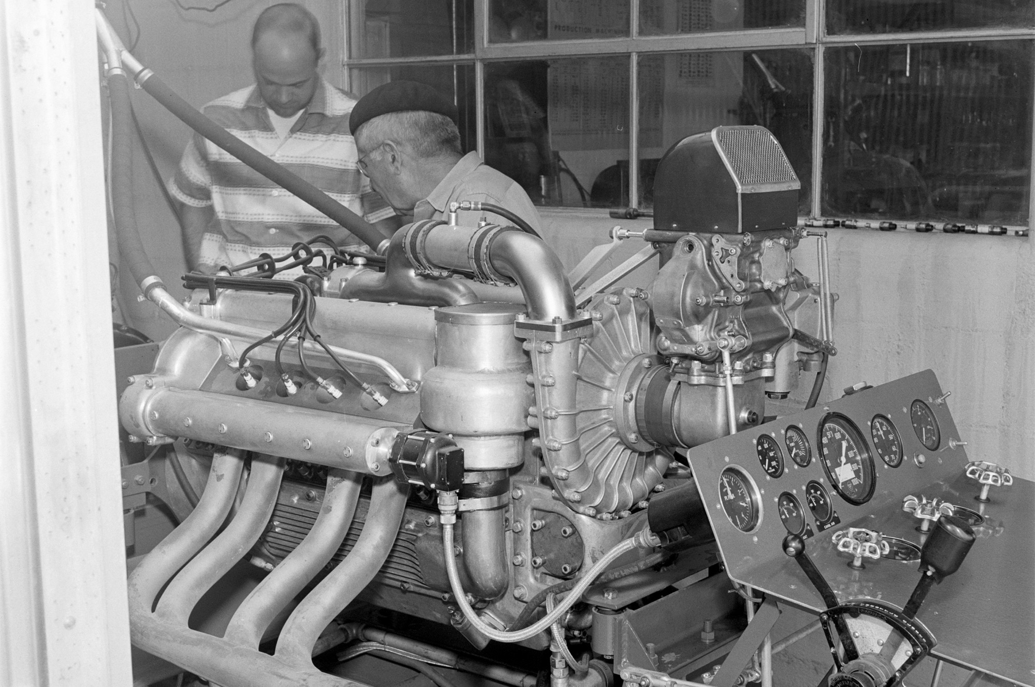 Here's an outtake of a shot from the same angle that HRM published (June '55). We like this one better because Technical Editor Ray Brock (left) and mechanic Jean Marcenac are behind the dyno, instead of obscuring its cool control panel. More than 600 hp was generated by the 183ci, Holley-carbed, supercharged Novi V-8 that Troy Ruttman ran at Indy.