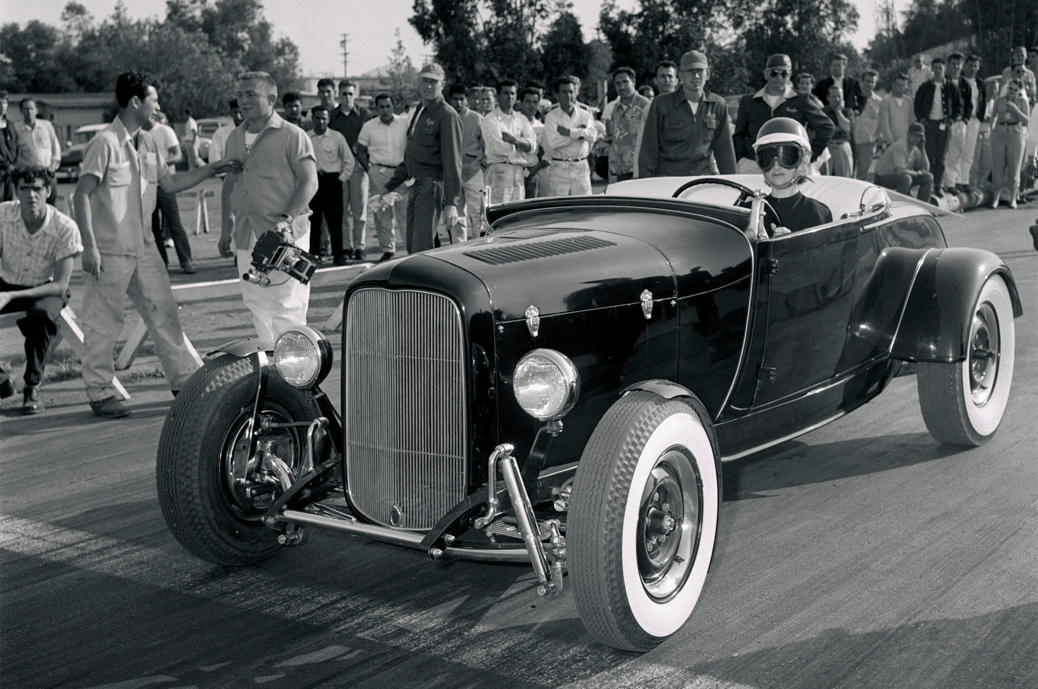 Another successful racer who's too often overlooked in listings of female pioneers is Helen Root, shown staging her and hubby Bart's A/V-8 at NHRA's Colton opener. Known for expertly shifting a Mercury gearbox at 6,000-plus rpm, Helen took the C/Street Roadster trophy here and nearly repeated at the Nationals, falling in the class final to national-record-holder Dale Ham, the future NHRA division director. Helen, Bart, and their two kids joined the sano roadster on HRM's July '55 cover.