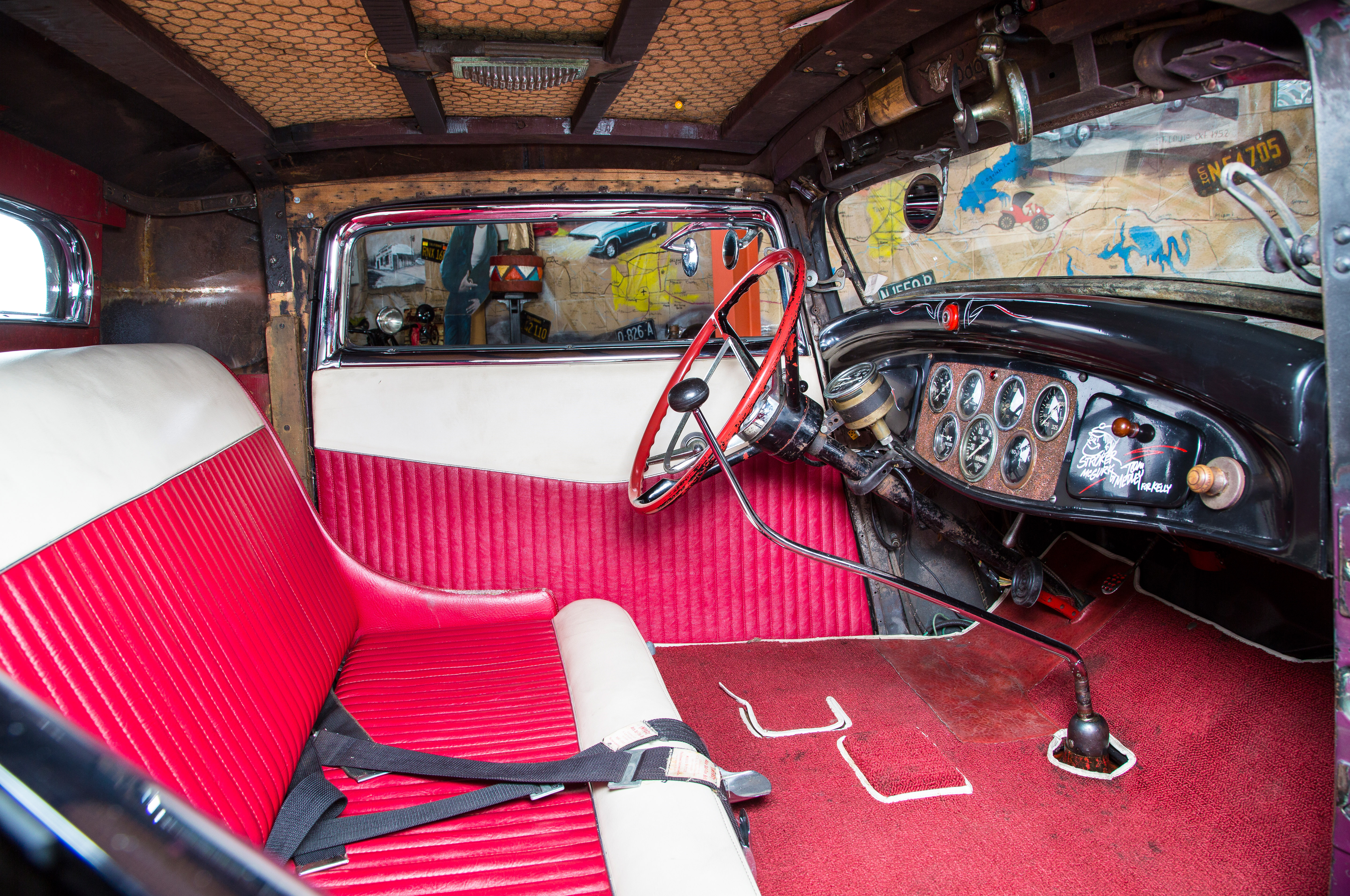 Not a lot of room in a chopped and channeled coupe. The wood supports and chicken wire in the roof are original; the upholstery and instrument panel are Bill's handiwork; and the '57 Ford steering wheel is from a later owner.