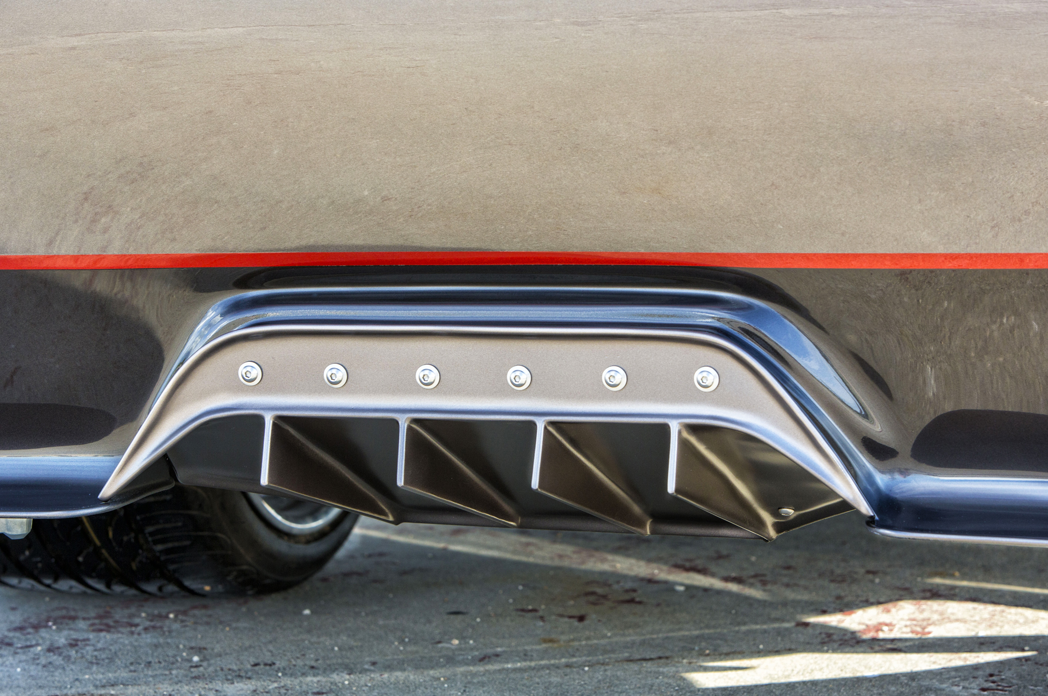 On a factory F-100, this is where you'd find the license plate, but Weaver Customs fabricated a diffuser to match the truck's racy new look.