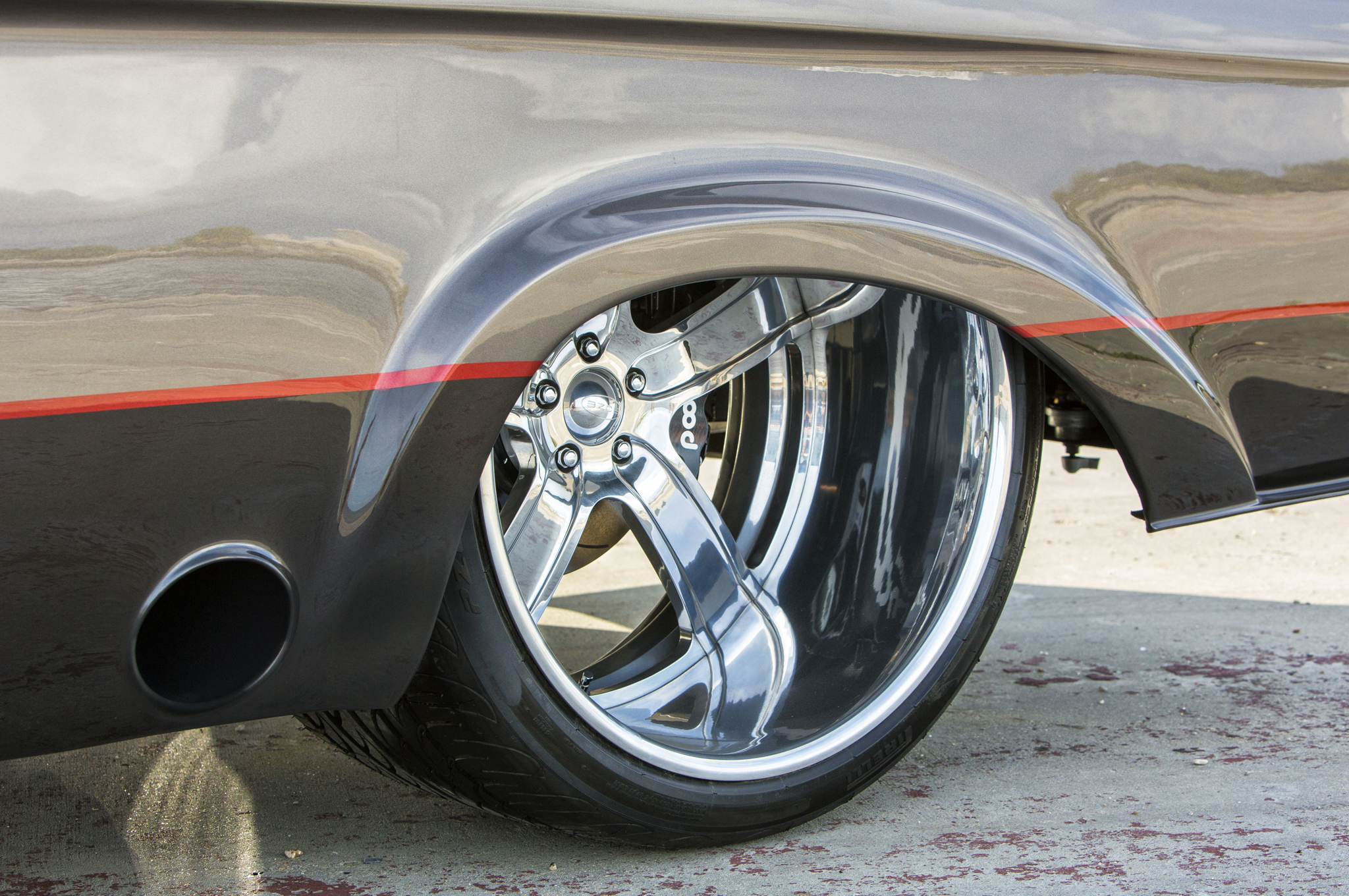 24x15-inch Boze Forged wheels wear 405mm-wide Pirelli rubber. After turning the compound turbos, exhaust is routed through 4-inch Flowmaster exhaust into 5-inch tips that exit just ahead of the real wheels.