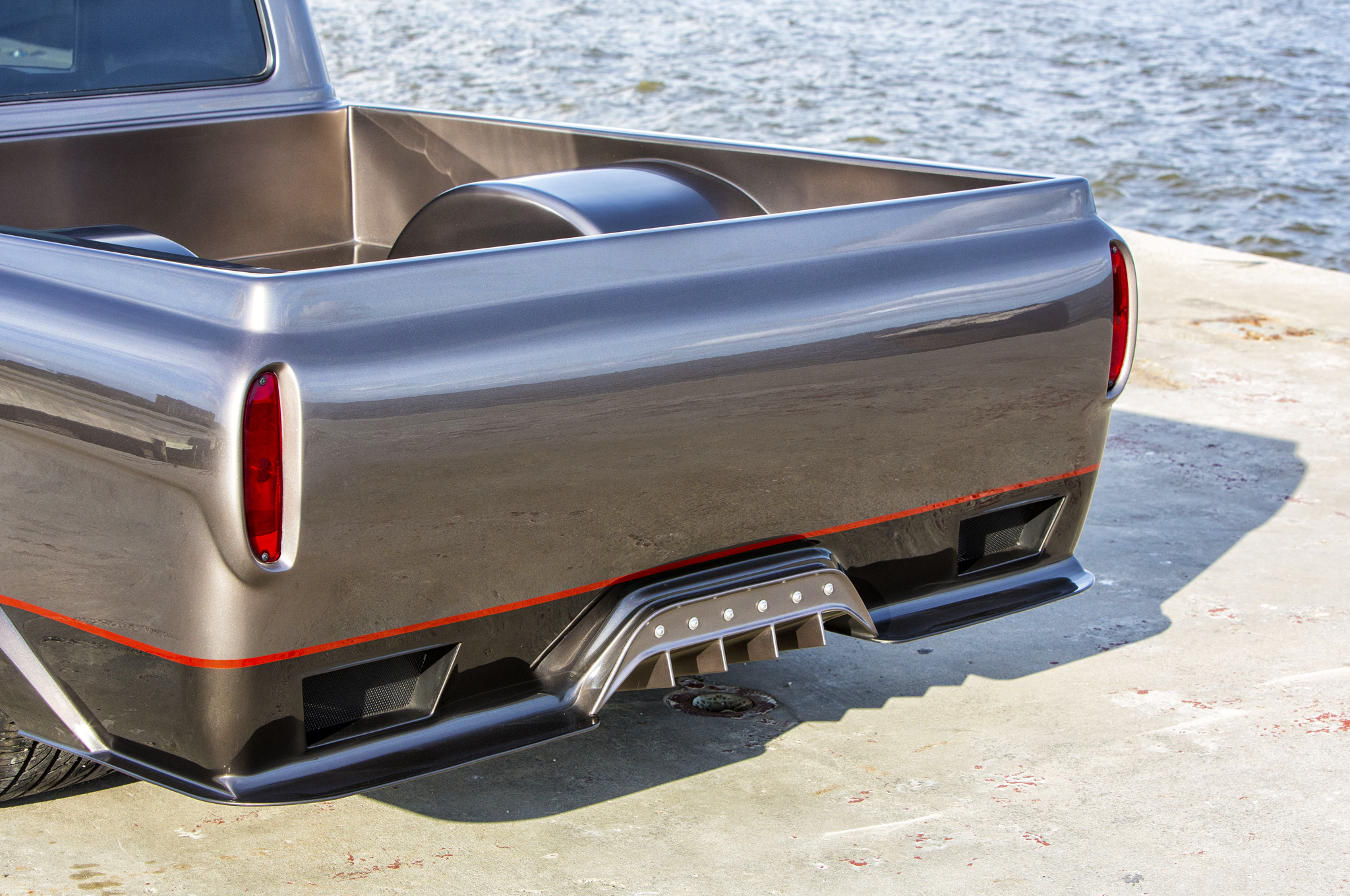 """The tailgate on an F-100 would have been recessed and stamped """"FORD"""" in huge letters. Now it's flush and shaved to eliminate all seams and gaps."""