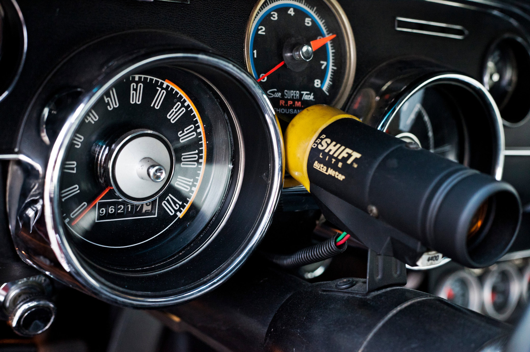 A Sun Super Tach is augmented with this Auto Meter shift light.