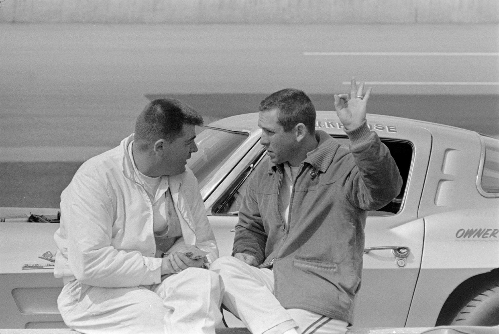 When it came time to race the big-block Sting Rays, Johnson said he wasn't going to drive the ill-handling machine, so Thompson had ex–Shelby Cobra road racer Billy Krause drive Johnson's car. Thompson is shown here (left) next to Krause (right) in front of what we believe to be one of the small-block-equipped Corvettes during practice.