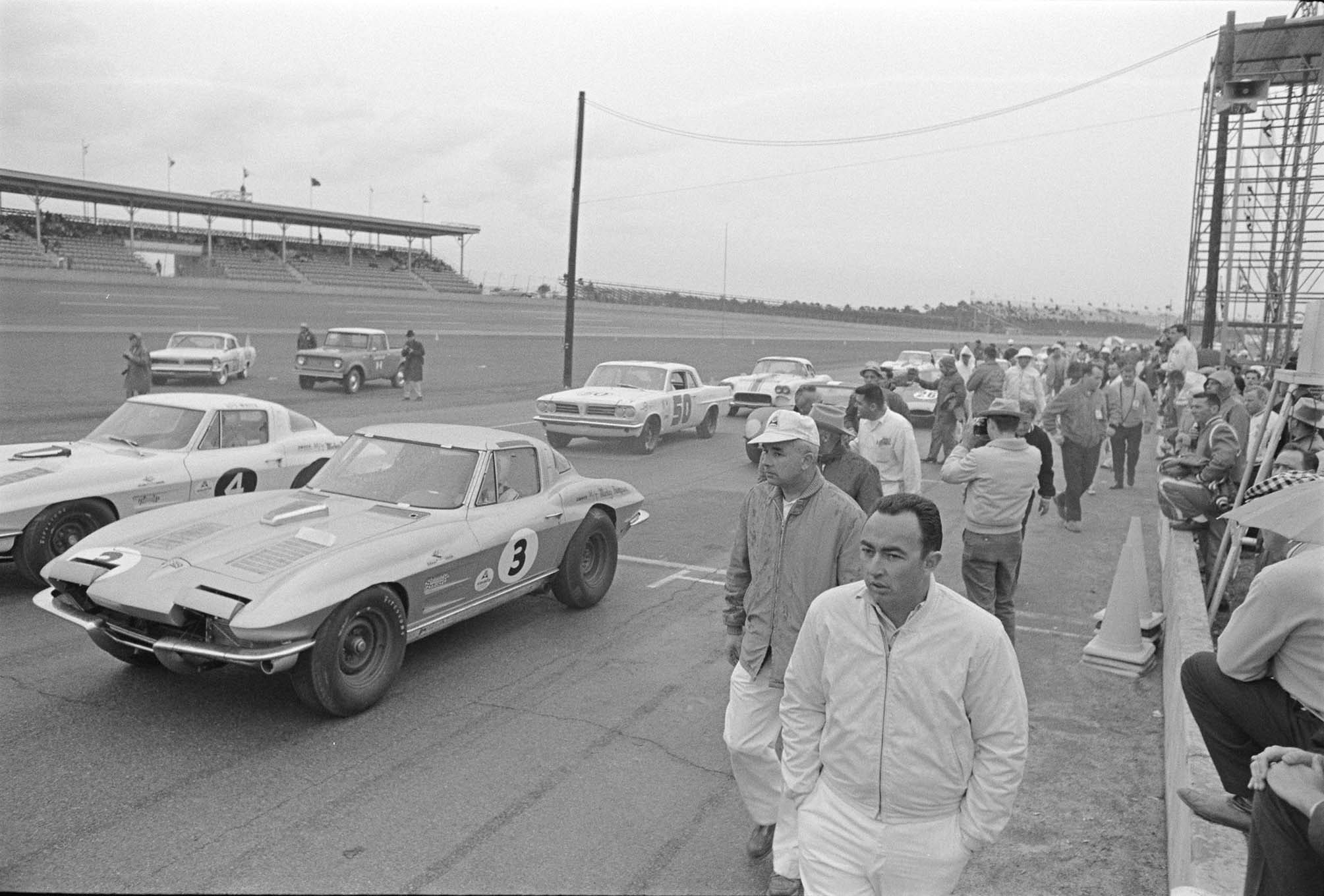 Rex White began the race in the white No. 4 car, and Krause replaced Johnson in the silver No. 3 car; notice the tape over Johnson's name on the No. 3 car.