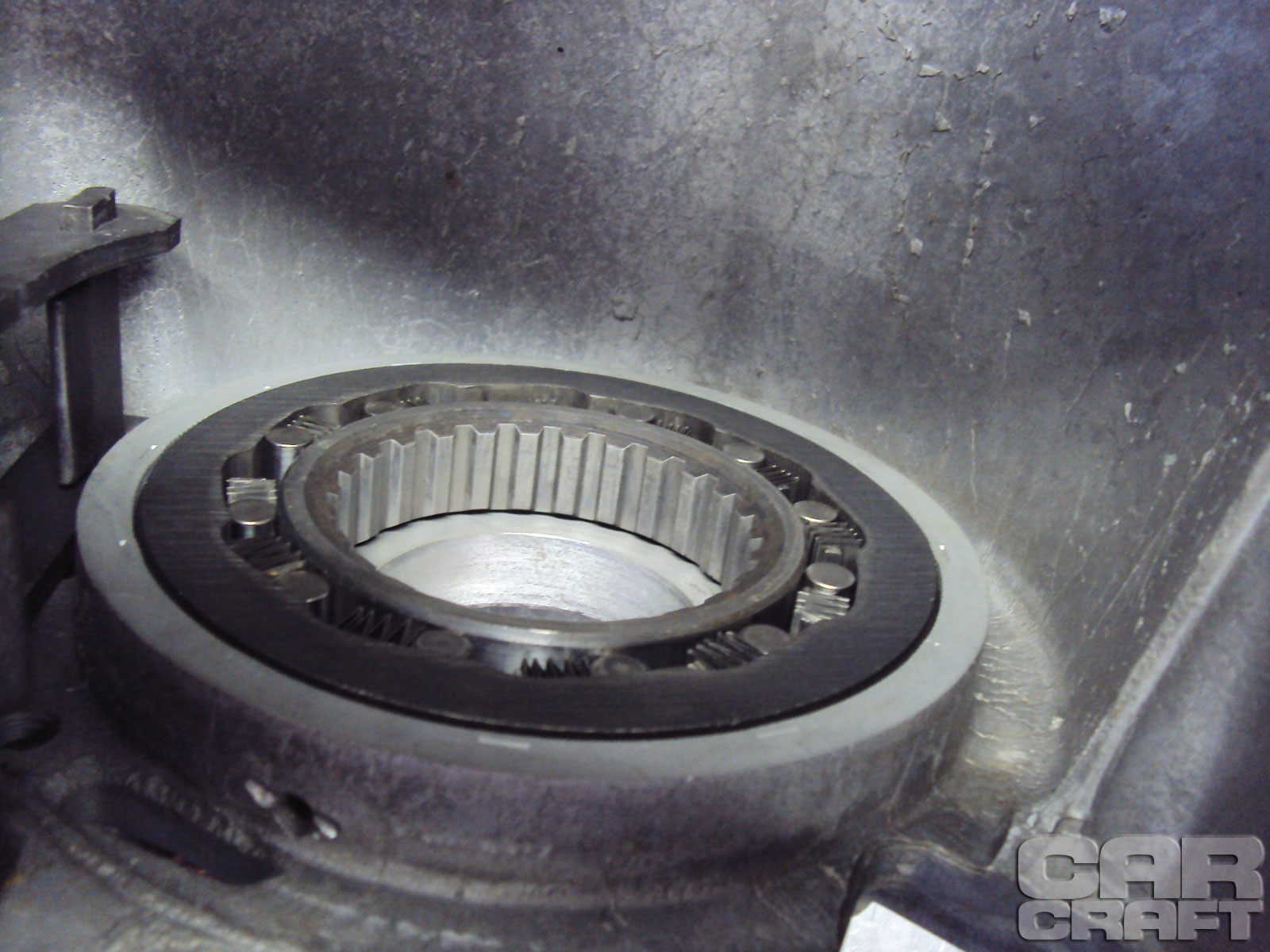 The overrunning clutch (aka sprag) is normally splined and pressed into the case. Performance Automatic replaces it with a bolt-in version if needed. If the spring and roller go bad, they can also be replaced.