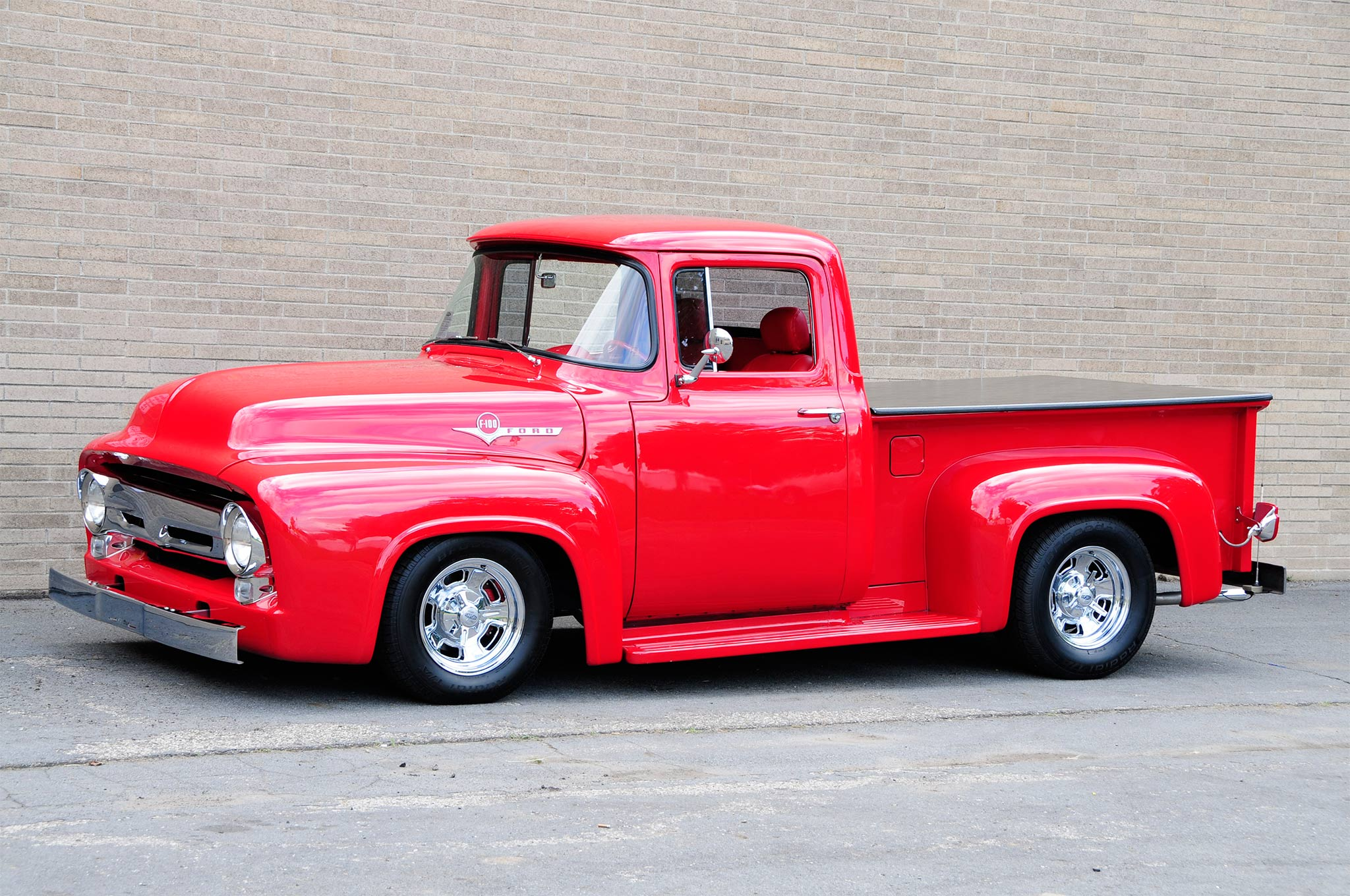 Sporting a perfect hot rod stance thanks to a Fatman Fabrications IFS the truck gets its good looks from a decadent coating of PPG Vermillion Red and plenty of fresh chrome accents. The Cragar Series 390C Street Pro wheels wearing BFGoodrich Radial T/A's are cool.