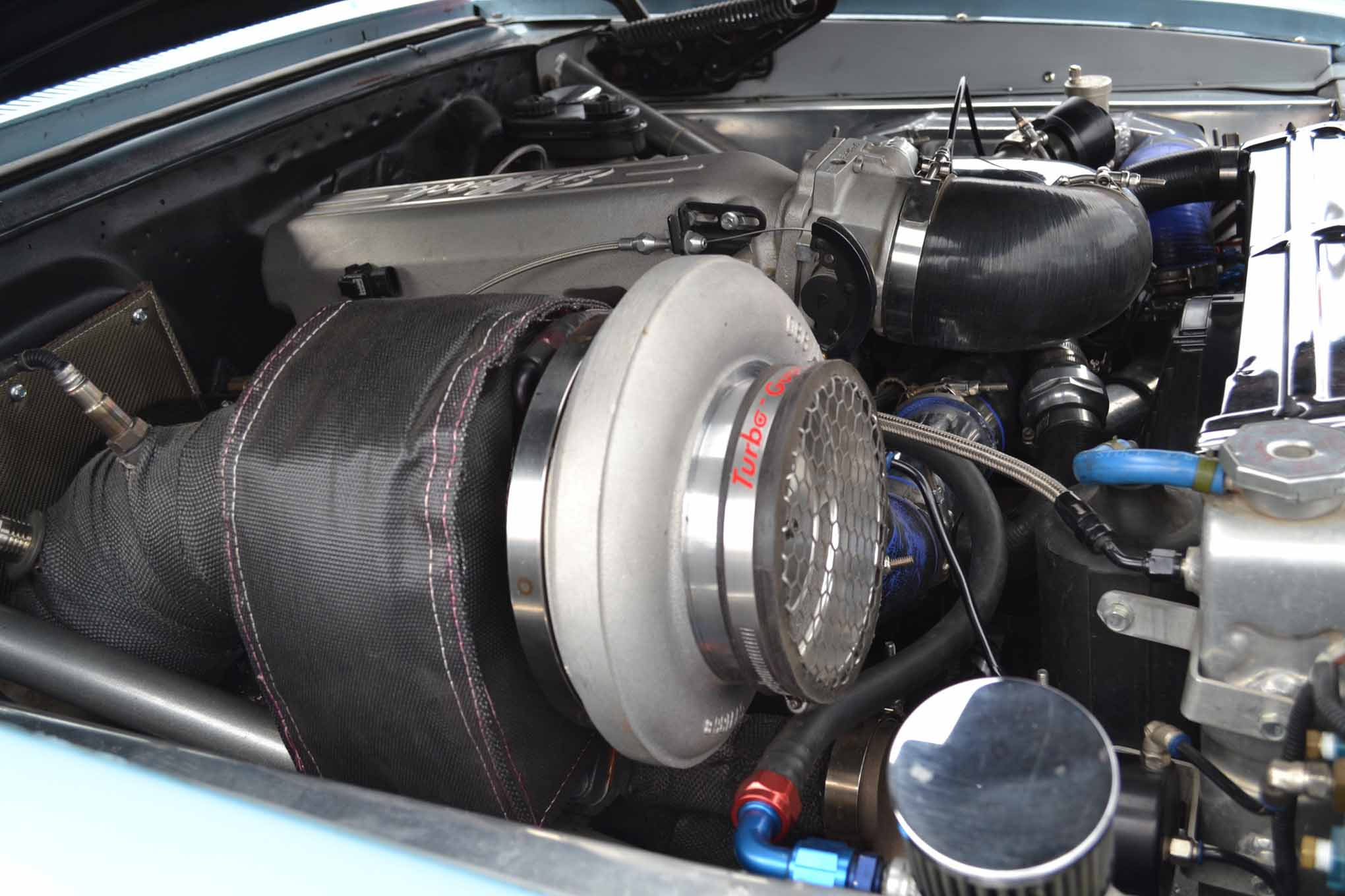 This LS-based engine propels a small-tire 1963 Nova street car to mid-8s, thanks to modern turbocharger technology. Even with a big, single 88mm on a relatively small engine, owner Jim Willis said the car is unreal in its driveability and cruises down the freeway at 80 mph, thanks to 3.20 gears.