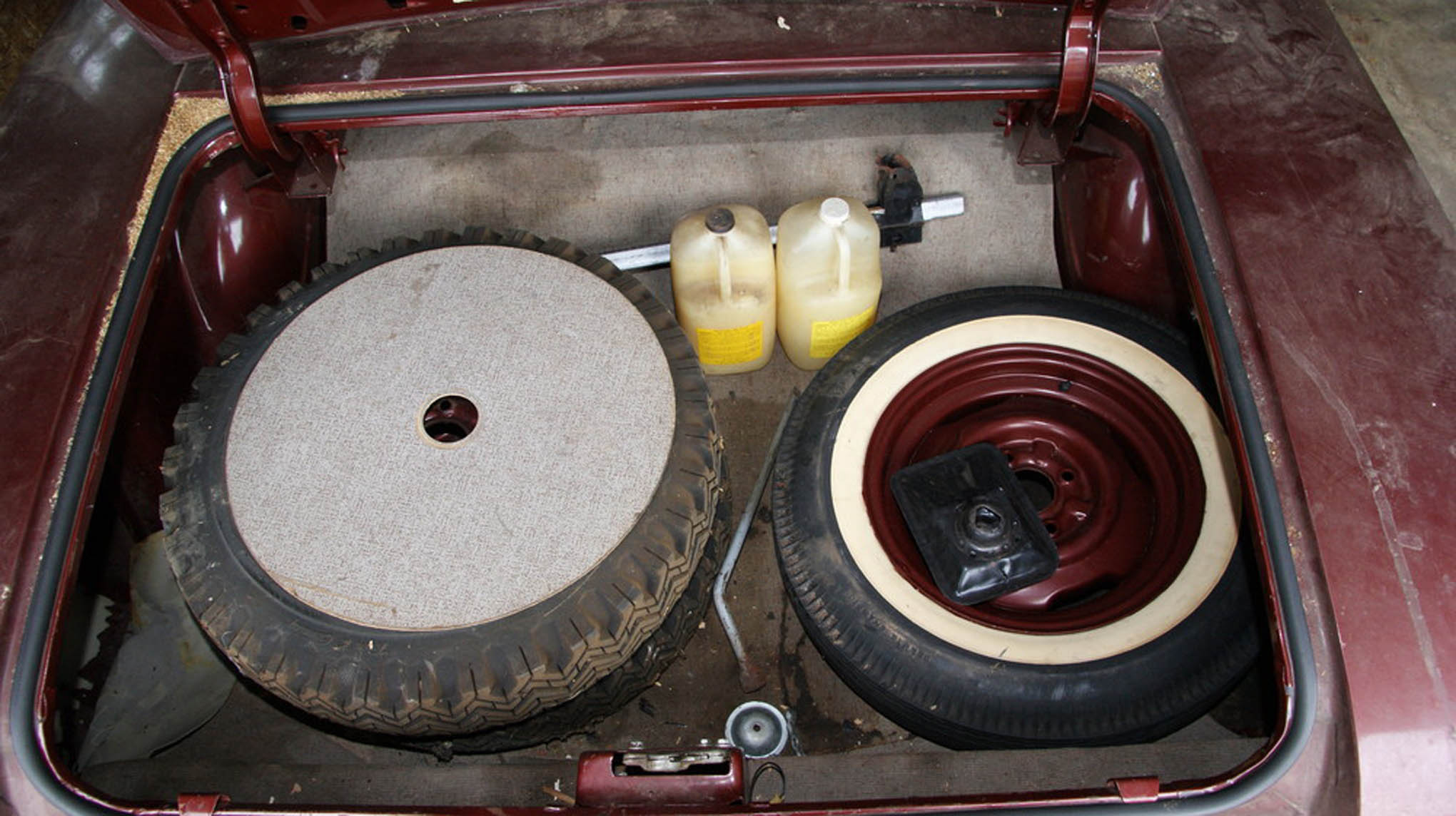 Two snow tires and two extra jugs of Oldsmobile Turbo-Rocket fluid were found in the trunk along with the original spare.