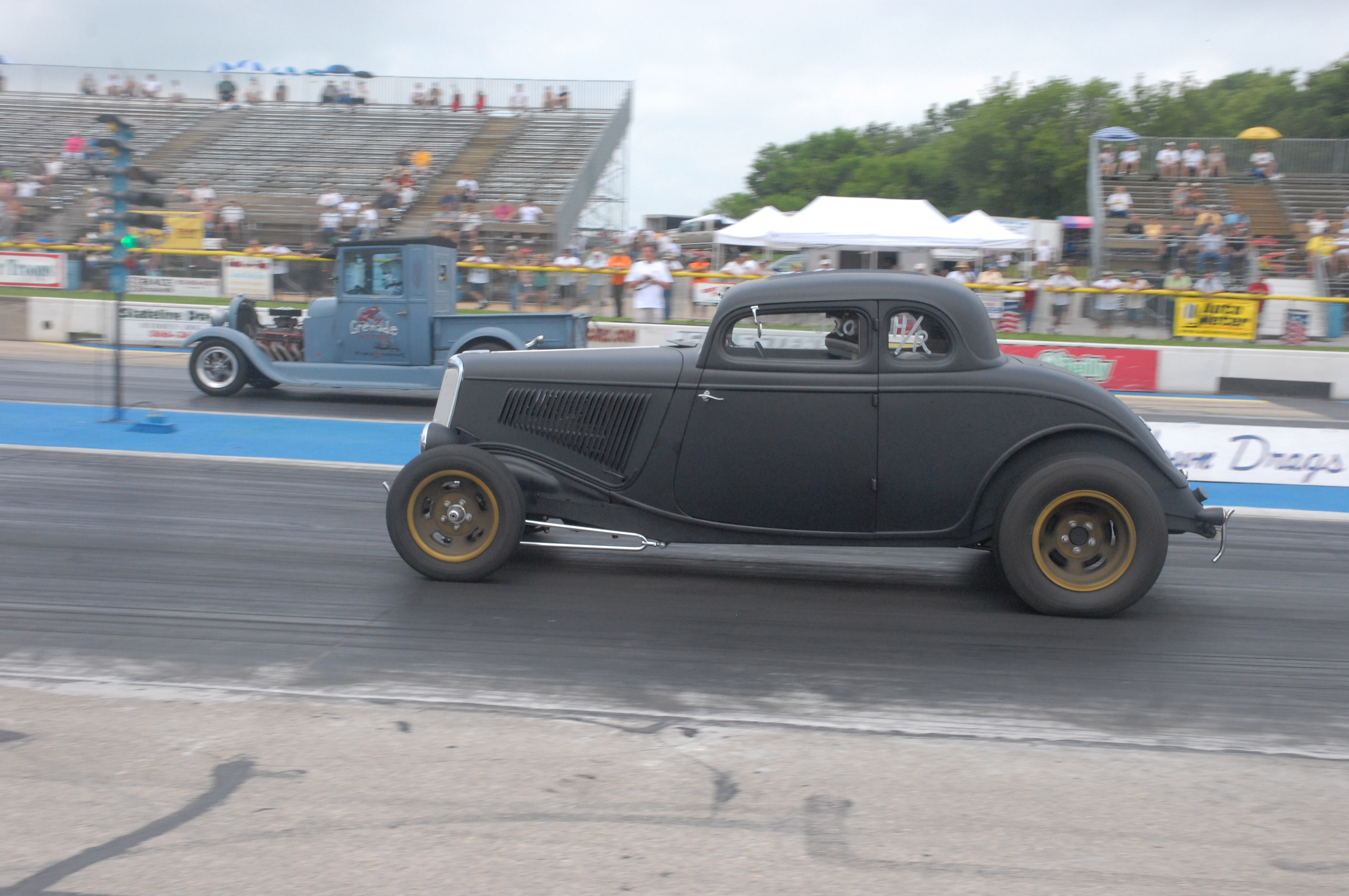 Cancer survivor Cheryl Kaiser, in her 1929 Model A pickup in the far lane, puts a sizeable holeshot on the '34 Ford coupe of Mark Stimeman. Cheryl has participated in all six Meltdown Drags events and made a total of 19 passes at Meltdown 2015. She is truly an amazing woman!