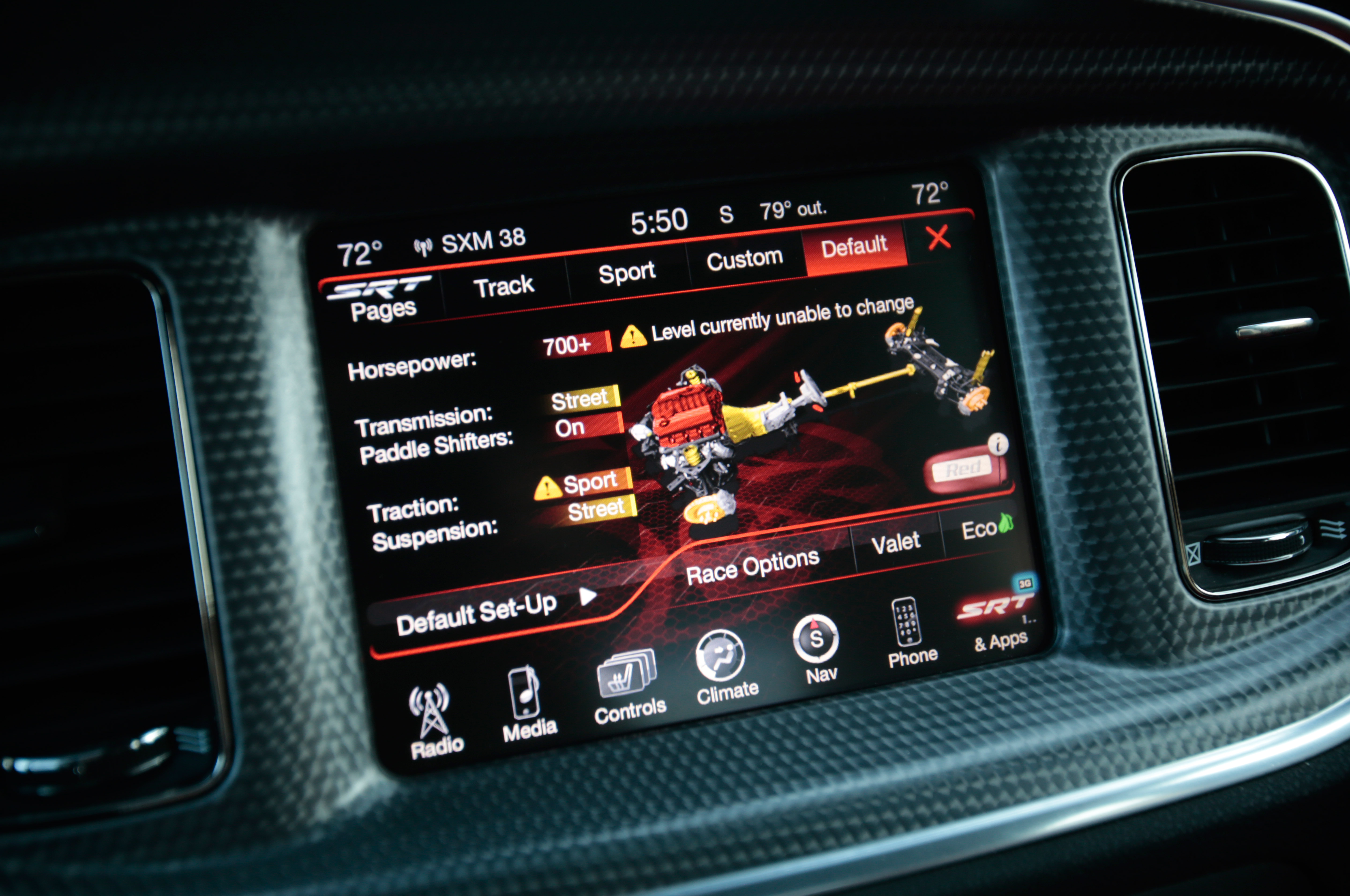 The Hellcat has an easy menu for adjusting settings, and once you program in your preferences, you can switch over from the default with a quick double-press of the SRT button. We found our street preferences also worked well on the track.
