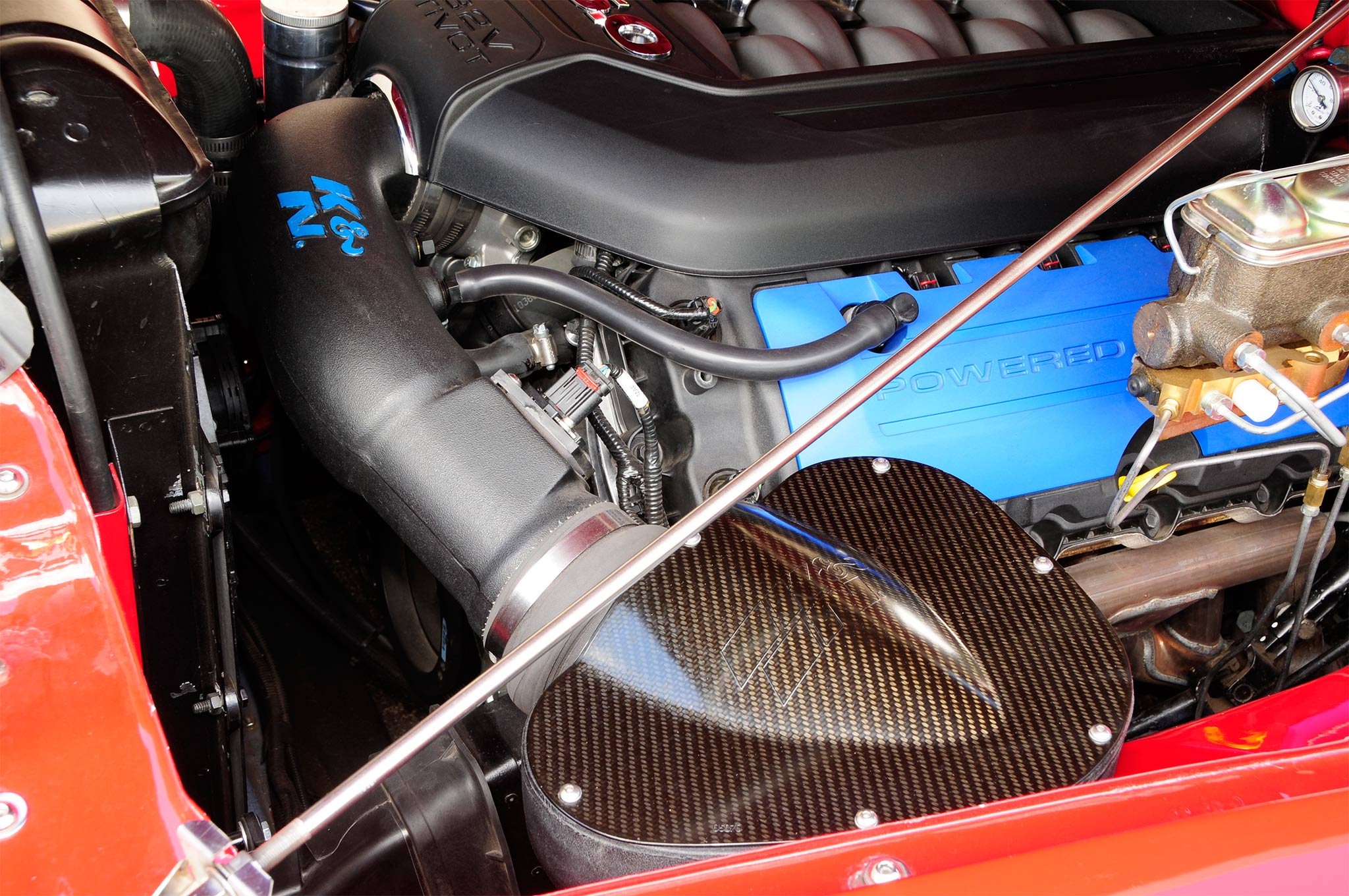 A K&N cold air intake with carbon fiber accents adds just a bit of racy detail to the engine as well as increase performance.