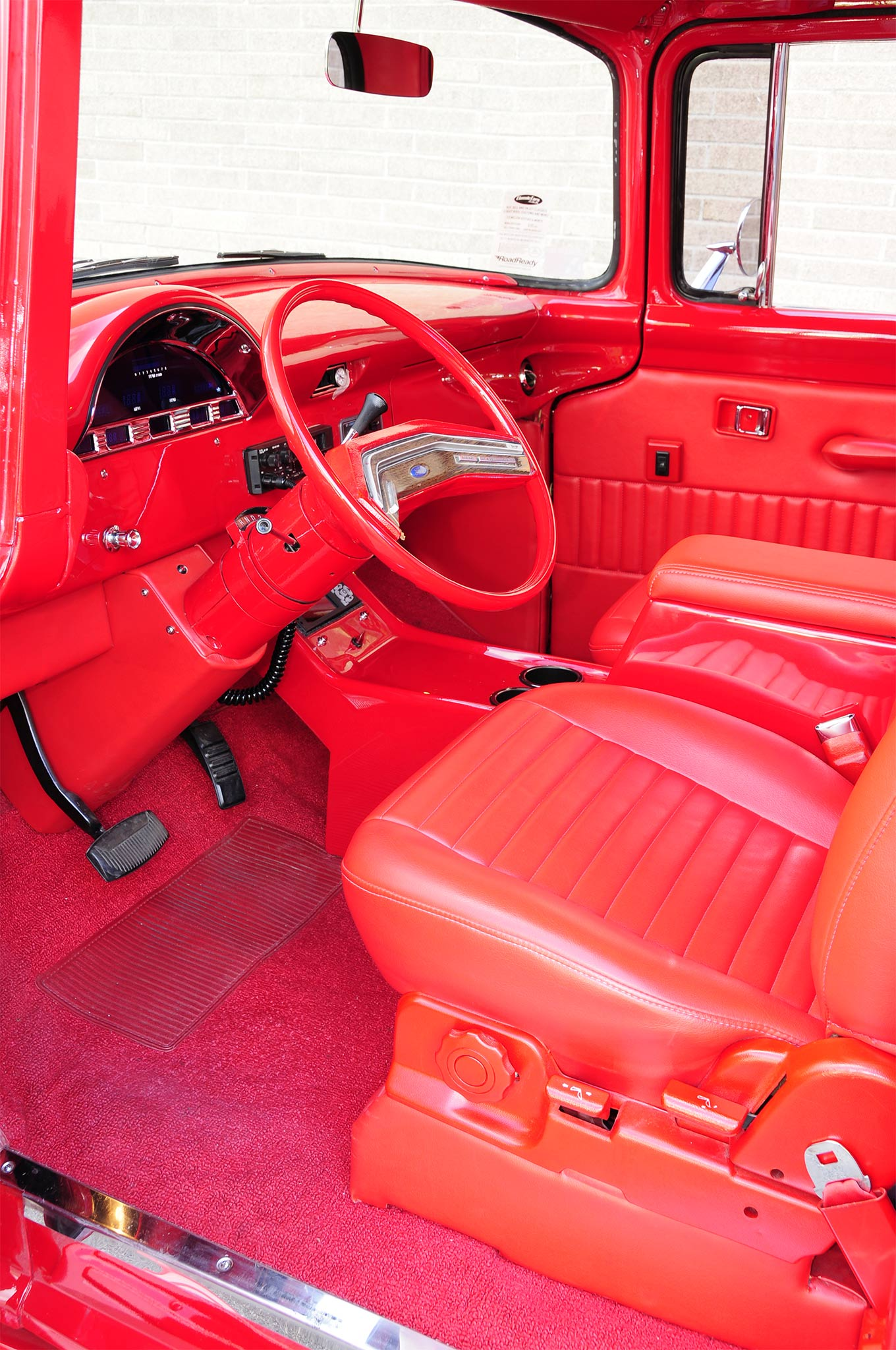 For plenty of comfort a set of Ford Ranger buckets were recovered in pleated red vinyl with complimenting door panels and carpet while a custom fab'ed console fills the gap.