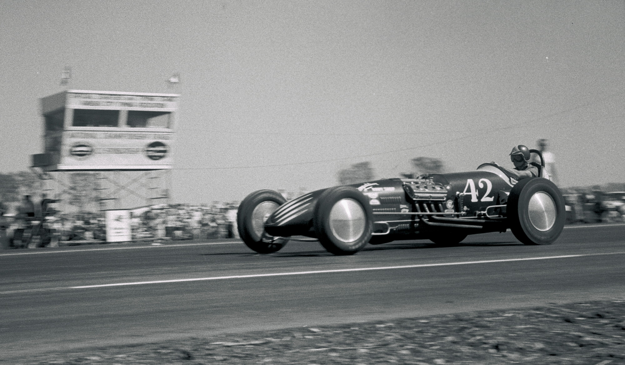 """NHRA moved its national event to Kansas City after losing Great Bend to the feisty American Hot Rod Association. Bob Alsenz drove Ken Lindley's Potvin-blown """"Miss-Fire II"""" to the meet's top speed and a new world record of 159.01, but lost the Top Eliminator final to Mel Heath. The L.A.-based fueler with Competition Body Shop paint and Von Dutch graphics did earn Motor Trend's Best Engineered Car trophy and a future HRM feature (Jan. '57)."""