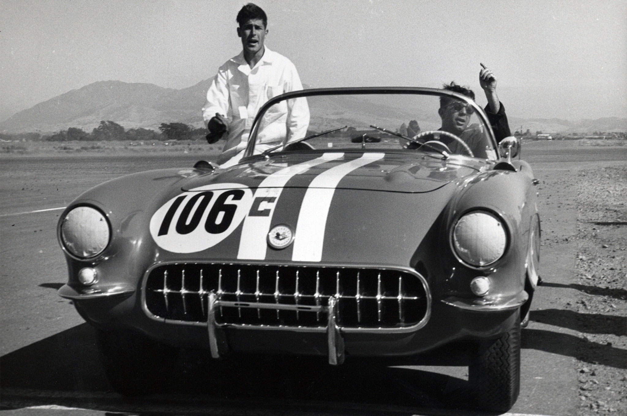 """A few weeks after boldly boasting to Chevrolet executives in Pebble Beach that a couple of magazine guys could road race a Corvette better than the Midwestern-based factory team performed in its first SCCA event, GM delivered a special one to HRM staffers Racer Brown (seated) and Bob D'Olivo. After a disappointing initial outing on original tires, Bob Pollack won regularly in California Sports Car Club competition, while Dick Thompson earned enough combined SCCA points driving both the Eastern and Western cars to bring Corvette its first national championship—at the expense of Mercedes, whose exotic 300 SL coupes were supposed to dominate C-Production. Among other modifications made in D'Olivo's home garage over the course of this historic season, the heavy windshield was replaced with a tiny windscreen supplied by Chevrolet Engineering. (Tech Editor Brown details the others in the Oct. '56 HRM: """"Rod Testing a 'STOCK' Corvette."""")"""