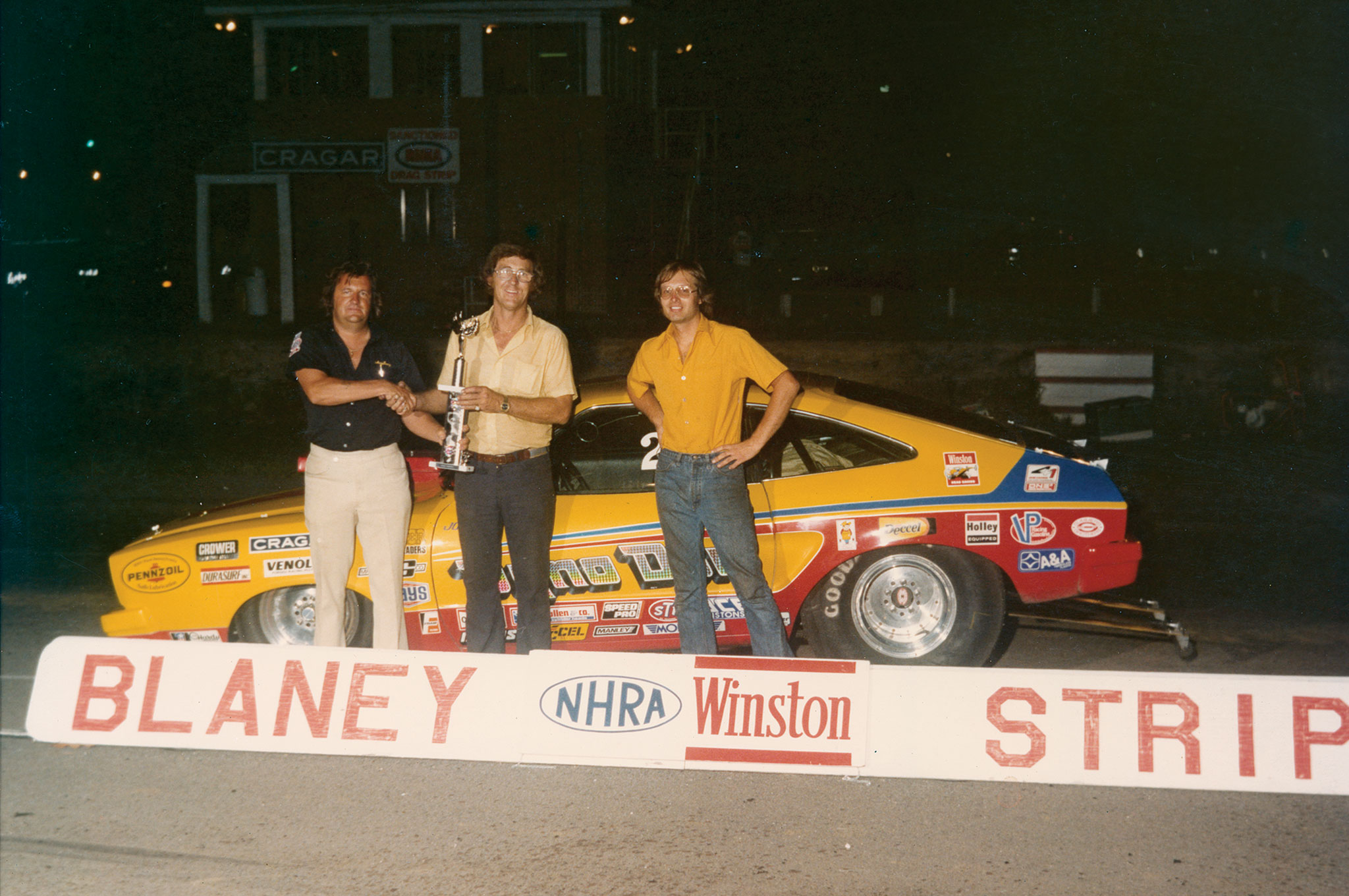 """While the Blaney Drag Strip in Elgin, South Carolina, is no longer, this photo has survived. Jon Kaase and Dyno are celebrating a match race win in the 1970s, perhaps over the likes of Sox & Martin or Bill """"Grumpy"""" Jenkins."""