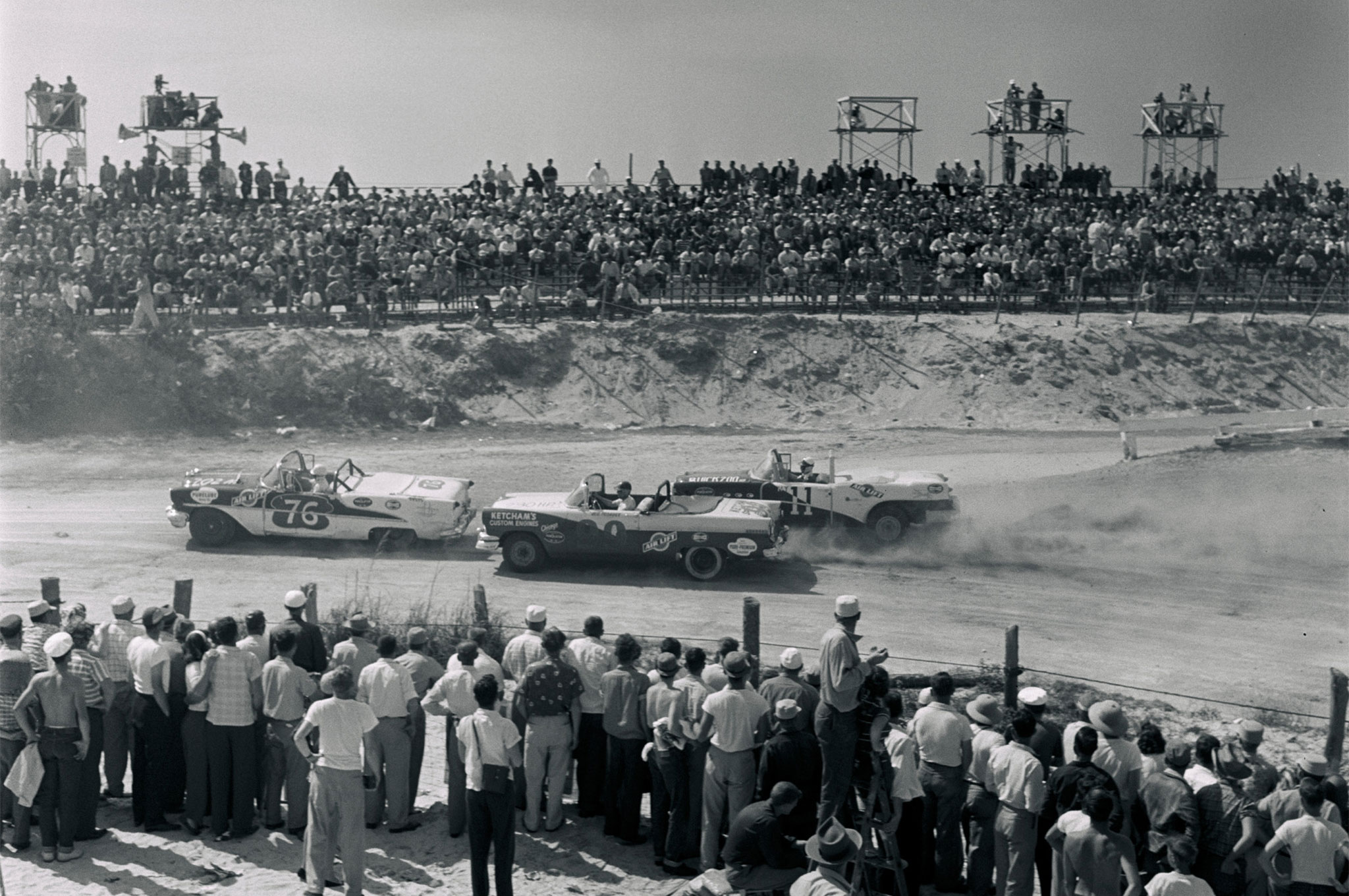 The debut of NASCAR's Convertible division produced an entertaining variety of 28 models, as illustrated by this tight trio of (from left) Larry Frank ('55 Olds), Gene Blair ('55 Merc), and George Bumgardner ('54 Buick). Ragtops ran the same 4.1-mile course and 160-mile distance as the Grand National hardtops. Joe Weatherly set the qualifying pace at 117.801, but Curtis Turner averaged 96.052 and edged Fireball Roberts in a one-two finish for Ford.