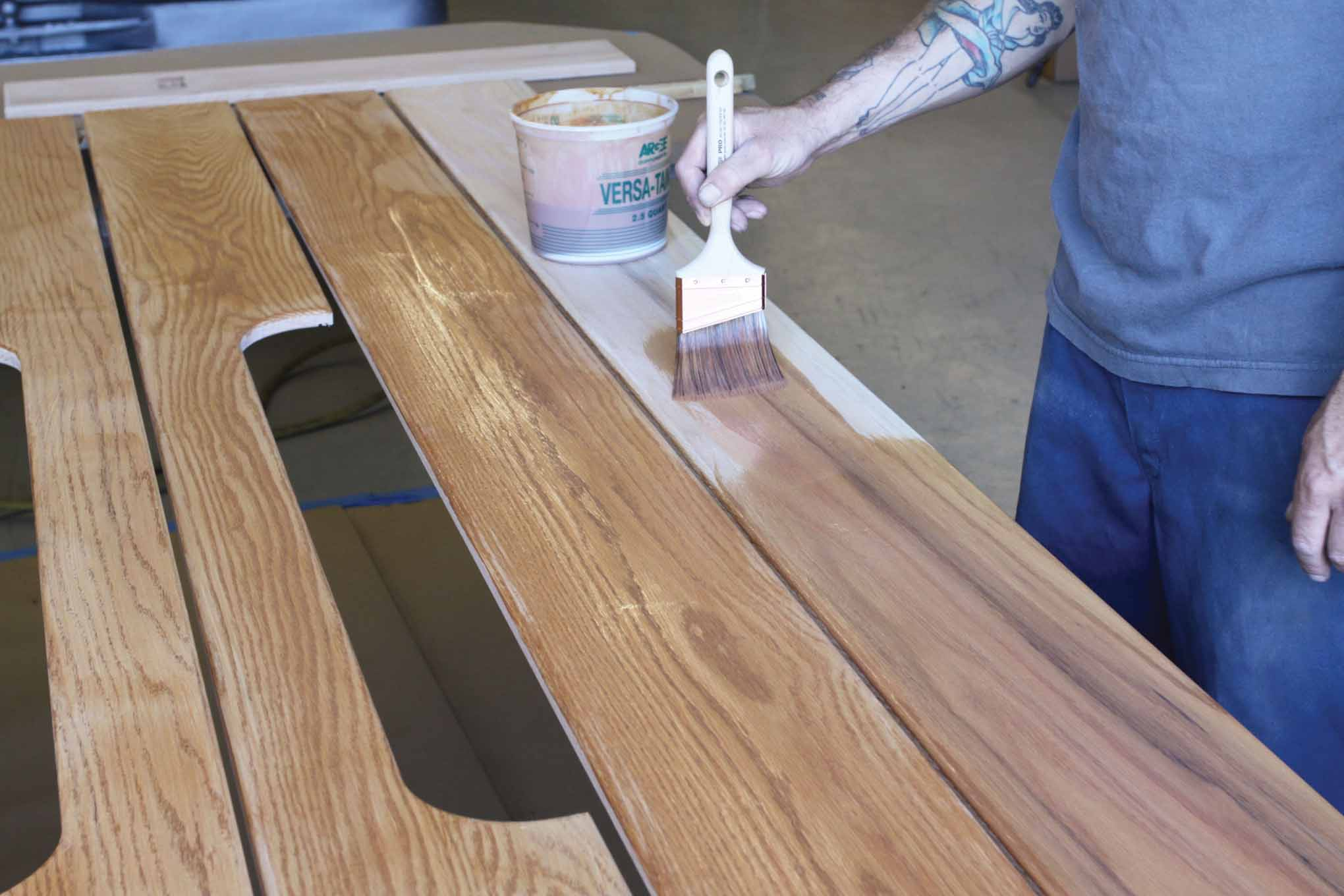 It's a good idea to seal the underside of the bed wood first. One coat was applied.