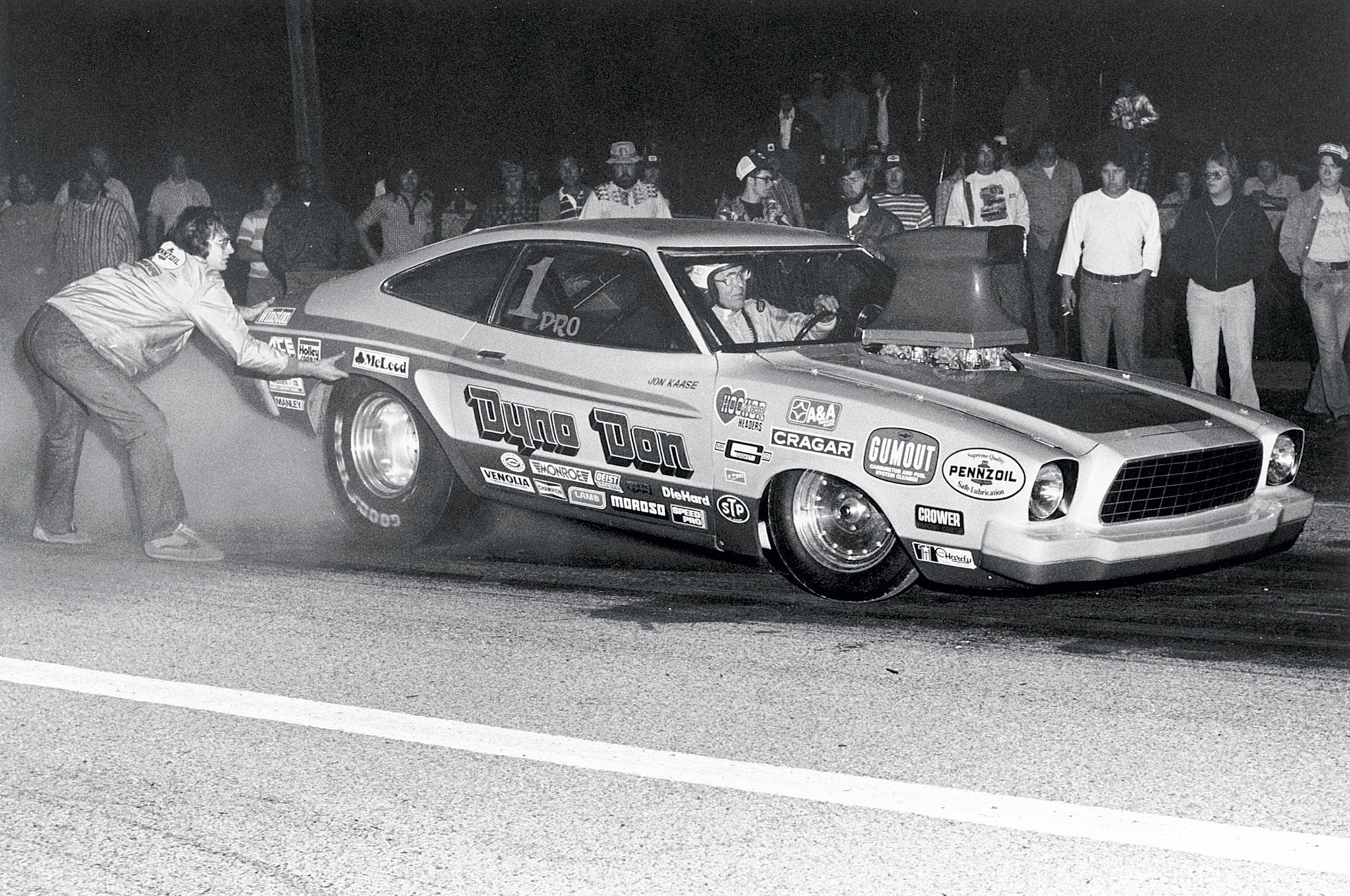 Back in the 1970s, it was acceptable to hold the corner of the car to keep it in the water. You can't touch the car now. Note the 1 Pro in the window. This is from 1978.