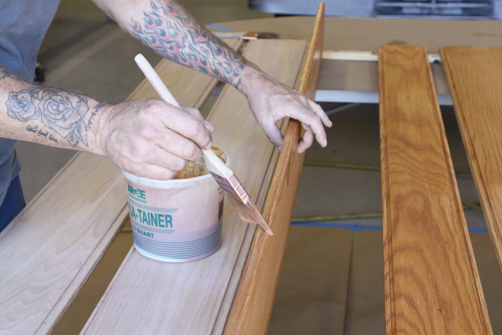 Paint the edges of the planks and then run the brush along the face of the plank to catch any runs.
