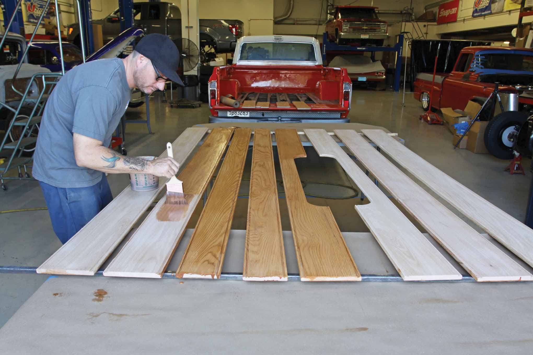 After removing a few grease stains with lacquer thinner on a clean rag, we stained the top side of the planks. The stain was allowed to dry thoroughly and then a second coat was applied.