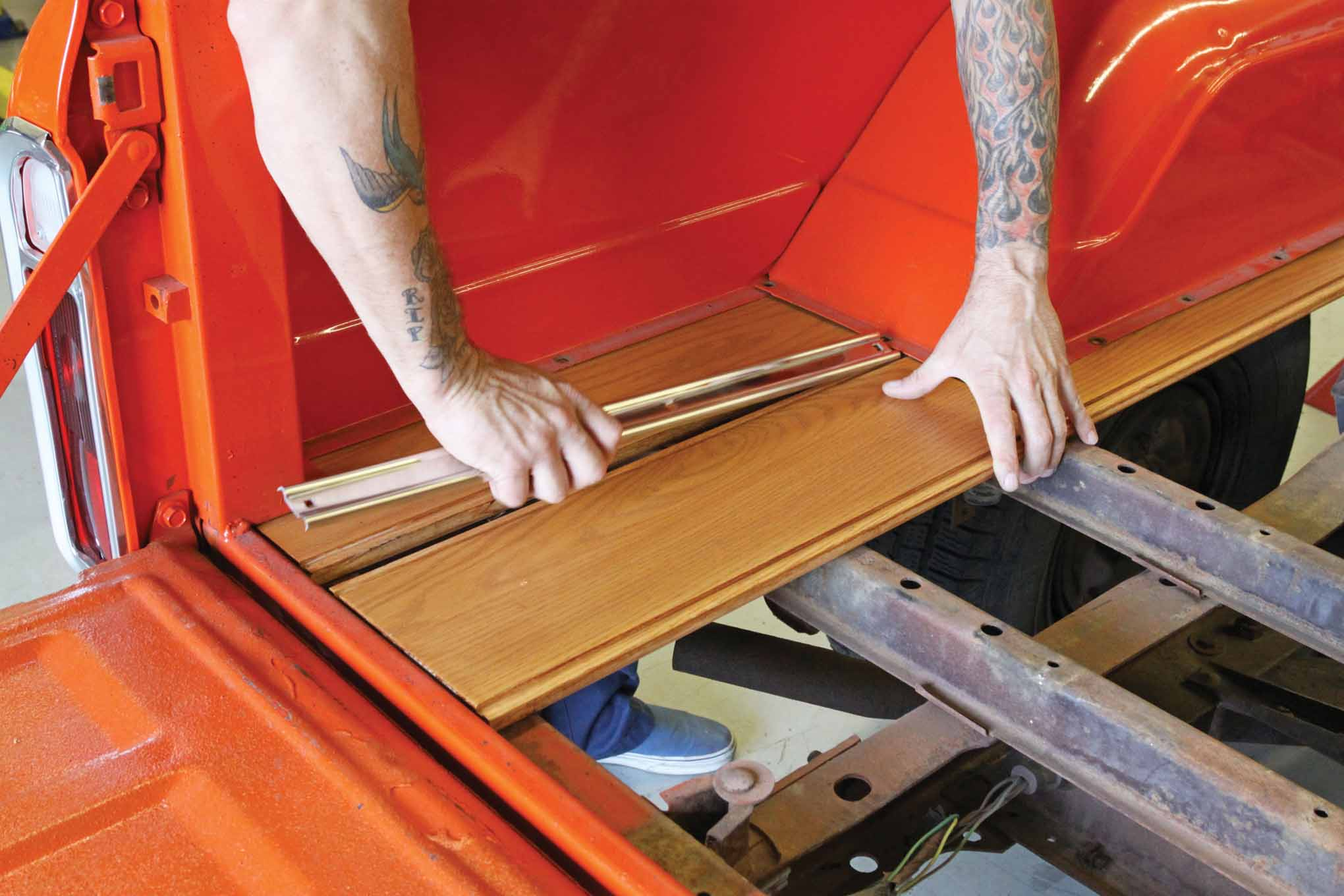 Mount the front and rear short bedstrips into place. Insert the polished stainless ¼-20 carriage bolts through the top to ensure they fit, but do not worry about installing the nuts and washers underneath at this time.