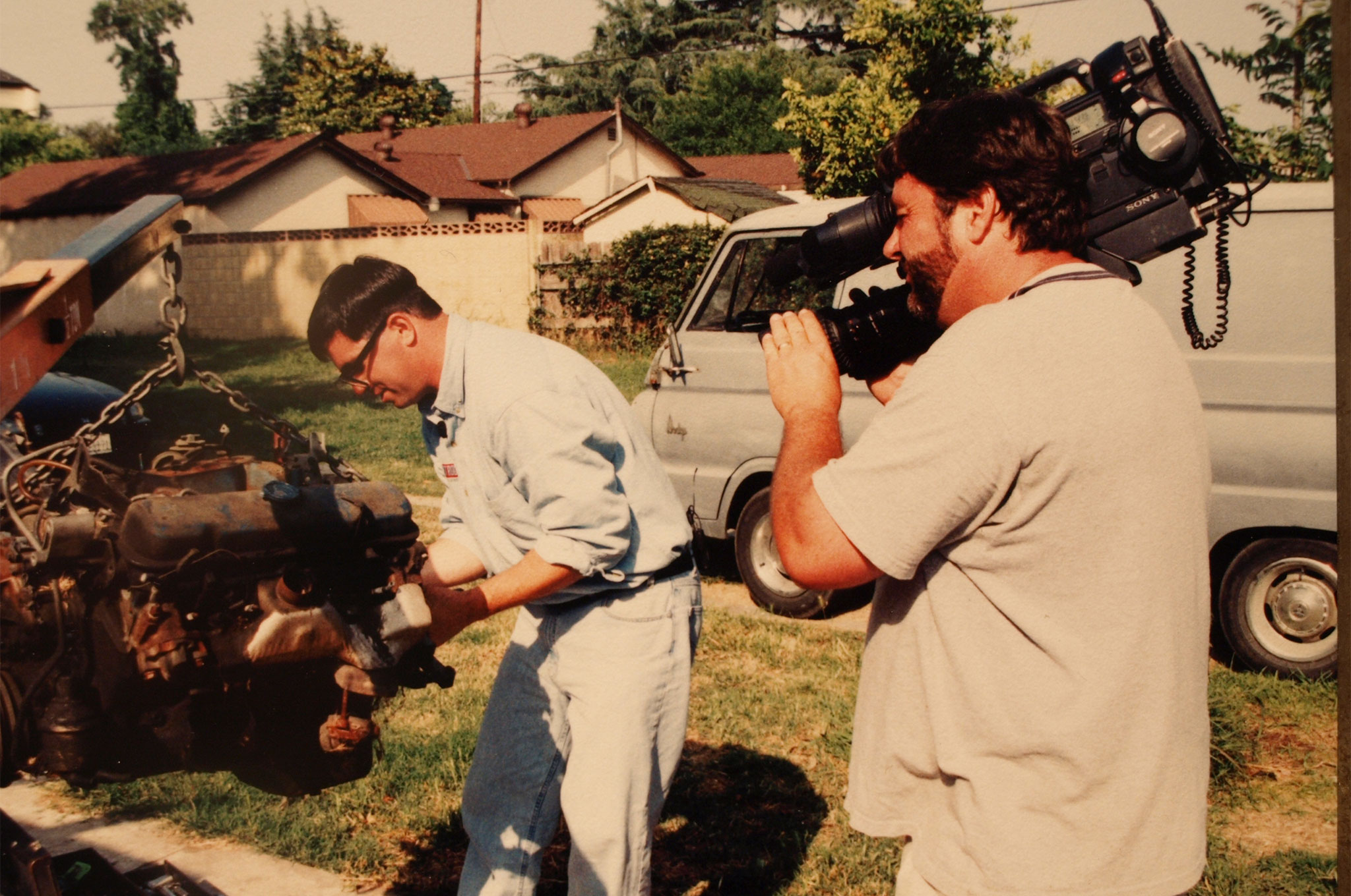 We shot a bunch of episodes of HRTV using the Hell Shack as a base of operations. Here, I'm about to tear down a junkyard-score Pontiac 455 for the camera. The engine belonged to my former HRM coworker Terry McGean, and he really did find the 7.4L treasure at Pick-A-Part! The cameraman was a freelancer named Jim, who was a veteran of numerous episodes of Cops. He always had wild stories to tell about close calls with criminals and high-speed pursuits. This shot was taken around 1998 (the covered carport hadn't been built yet). I paid $550 for the 1965 Dodge A100 van in the background. You could score them all day long for less than a grand back then.