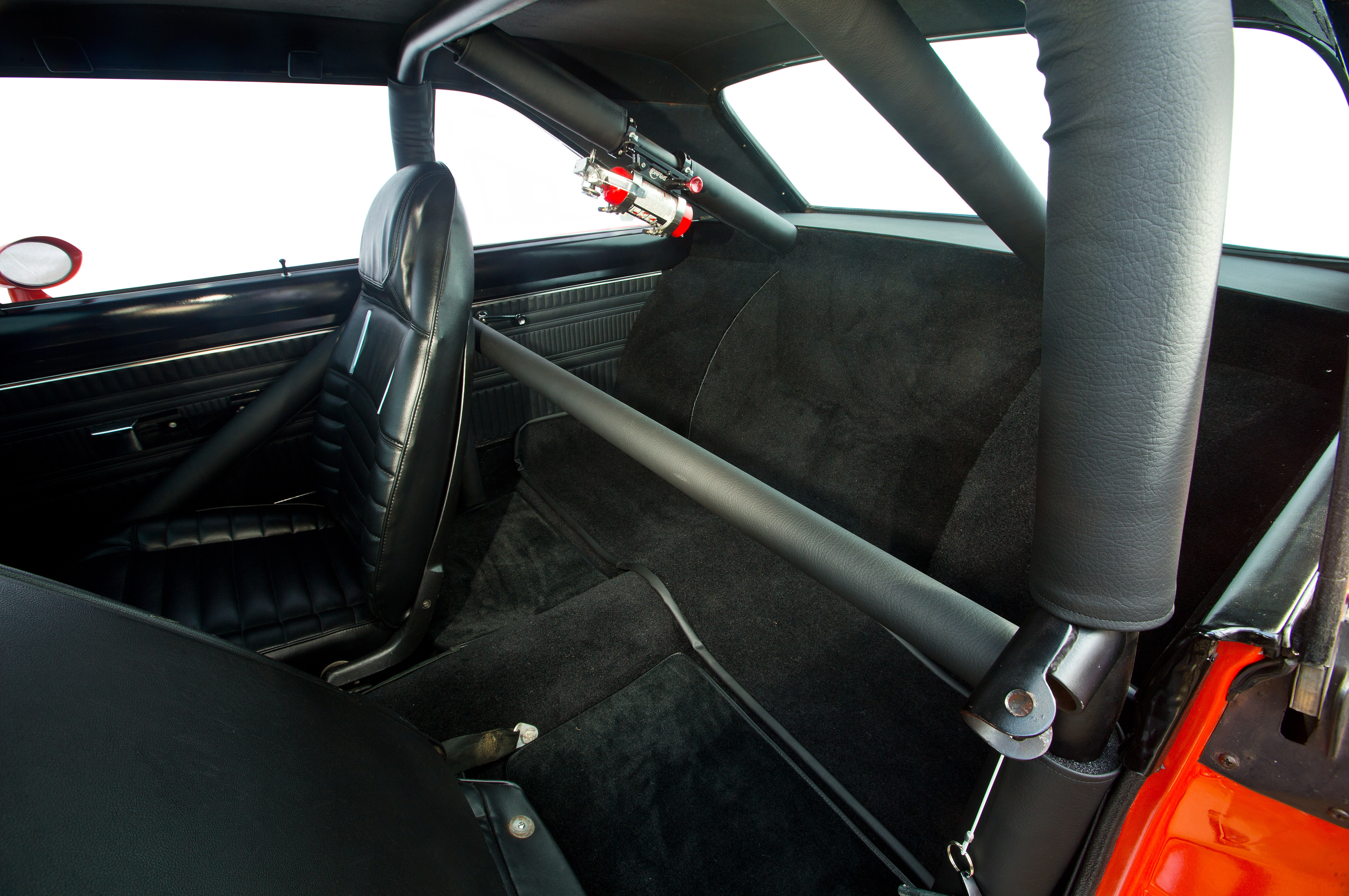 As purchased, the Dart's prior owner didn't bother covering up the tubs with carpet. After installing some sound dampening mat, Larry laid down custom-cut strips of carpet for a more civilized appearance.