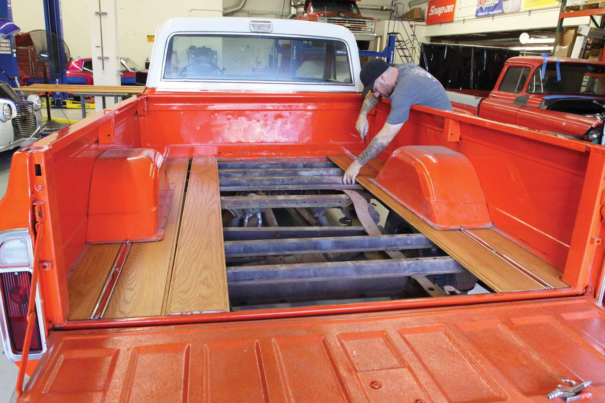 There are four bed mounts: two at the front and two at the rear underneath the third plank on each side.