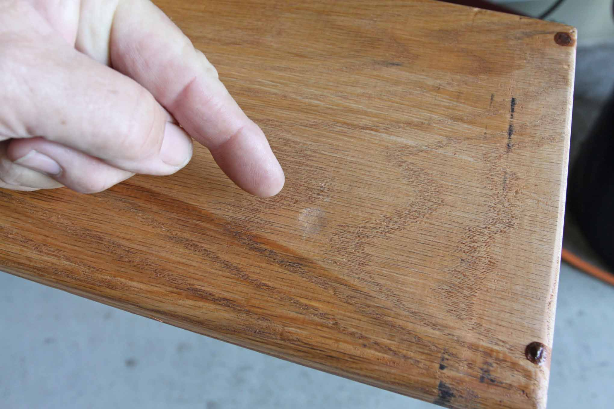 Here's a close-up of how the bed-mount bolt head impression should appear. We drilled the hole, bolted the plank down and hammered the other end to get its impression.