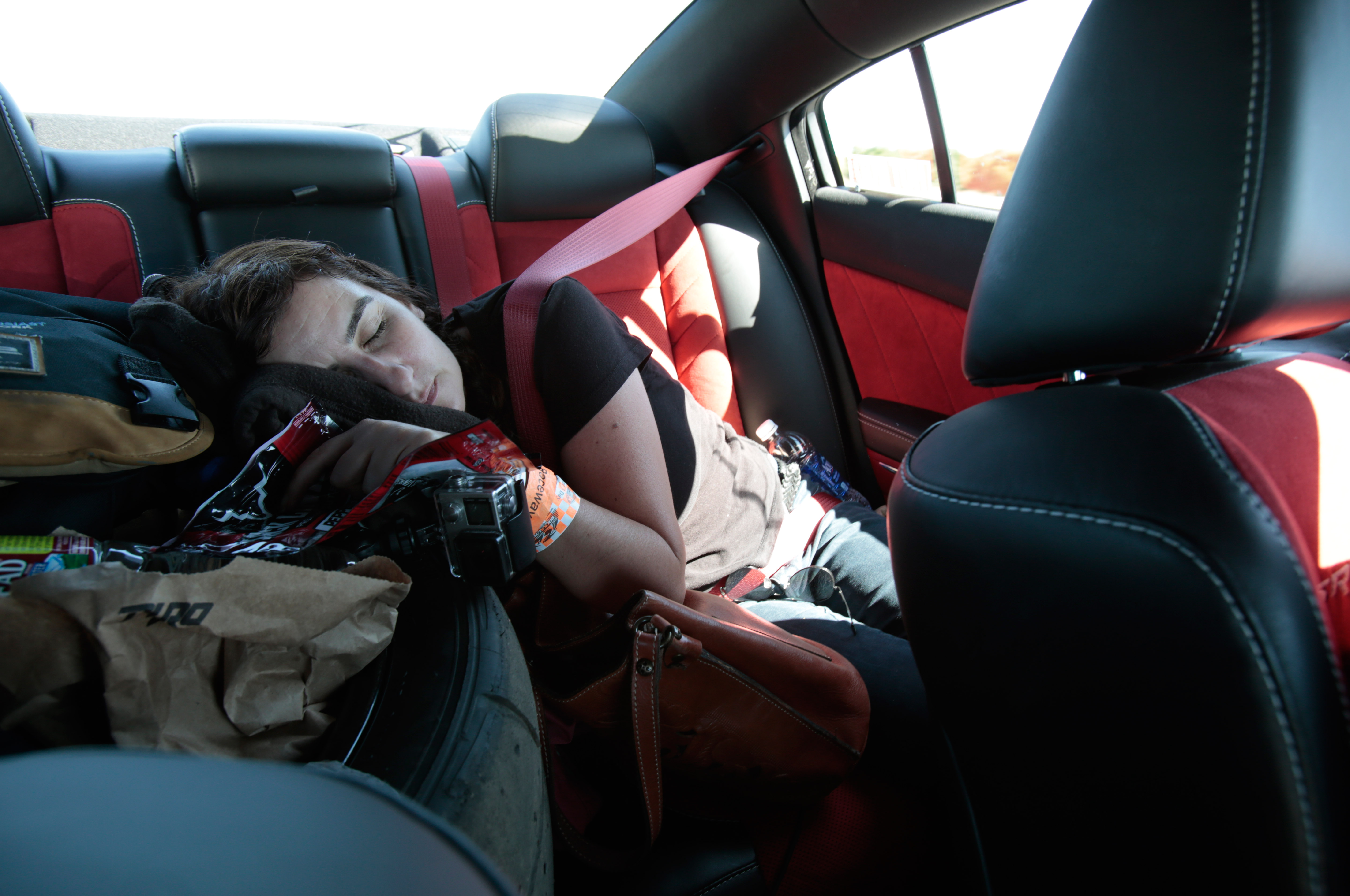 With just one track left to go, and no sleep for days, the soft Nitto tire in the back seat became a coveted nap spot.