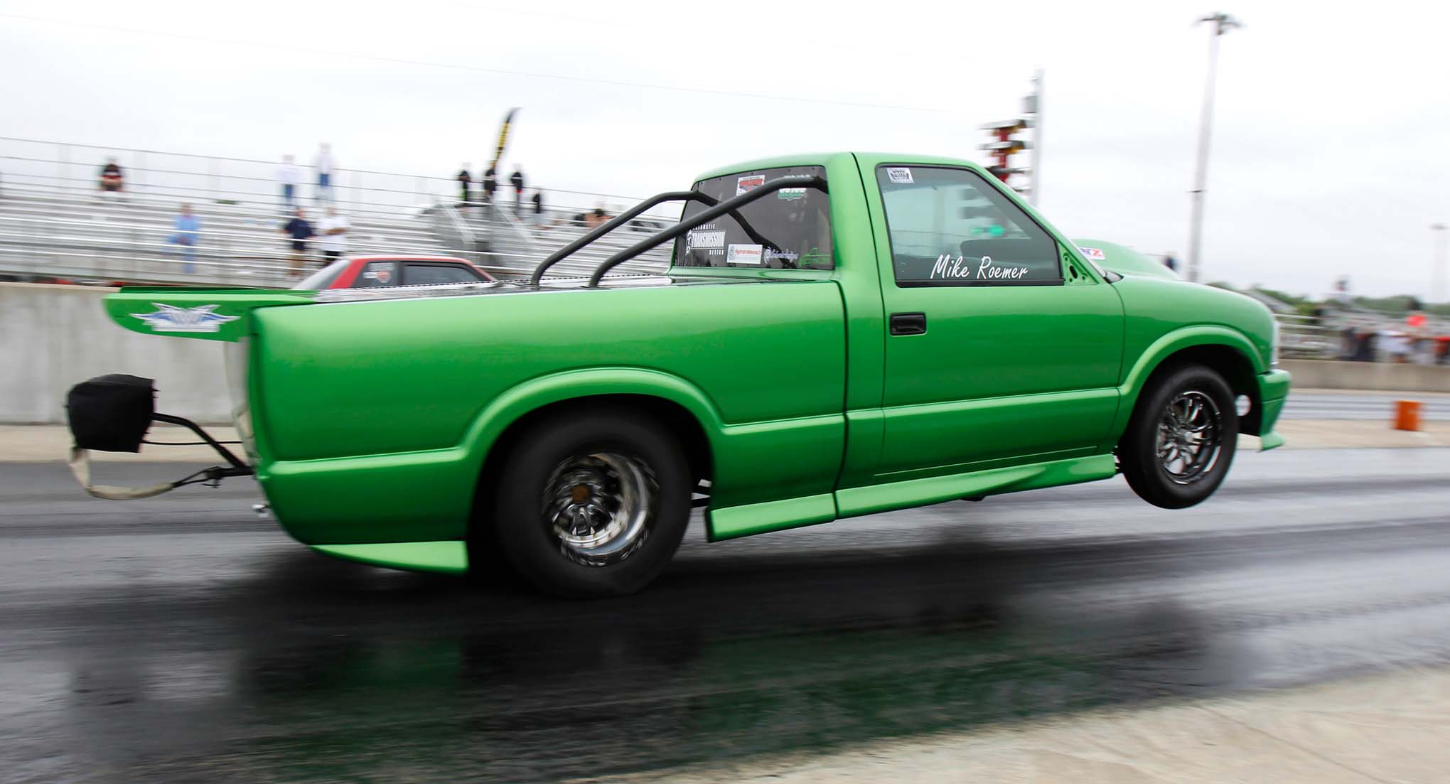Michael Roemer, a 22-year-old, carries the wheels of his 1994 S10 at Prize Fight 2 at Ohio Valley Raceway. The Flying Pickle is knocking on the 4s in the Ultra Street Class.