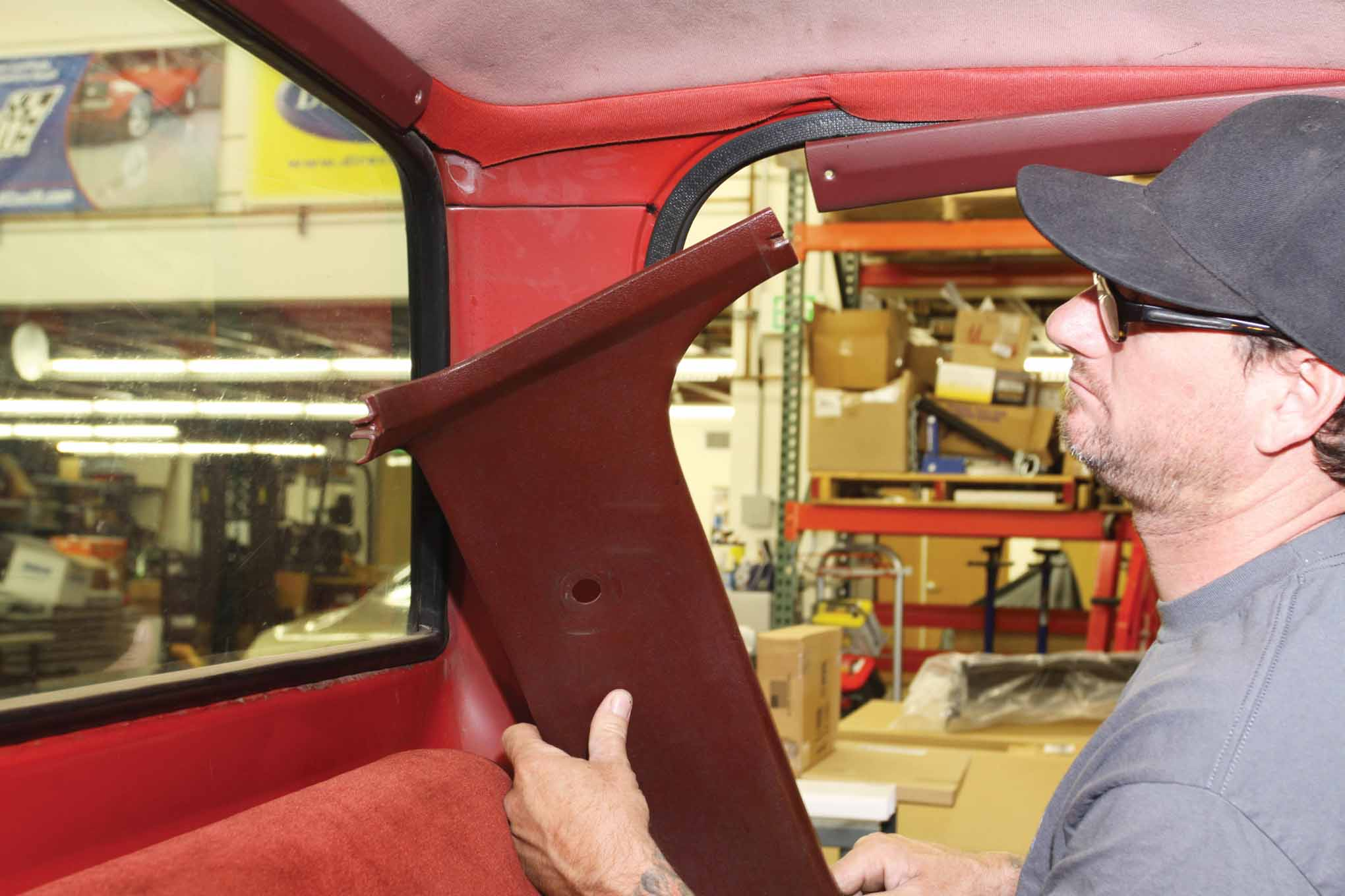 The first step to replacing the factory original headliner with a new ABS plastic headliner was to  remove the interior cab molding components.