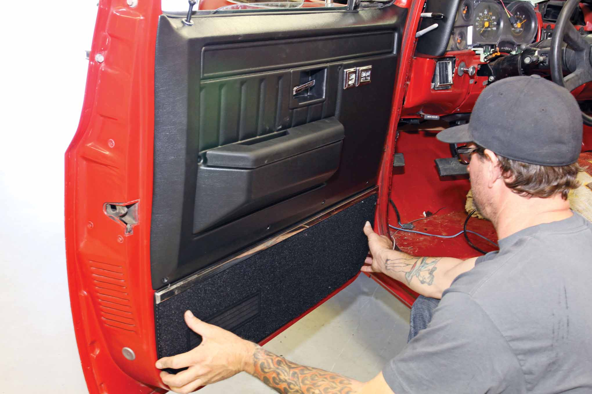 New door panels make a major improvement in appearance. The old ones unscrewed and popped up away from the door. The new door panel was hung over the door with the window down and then tapped down into place.