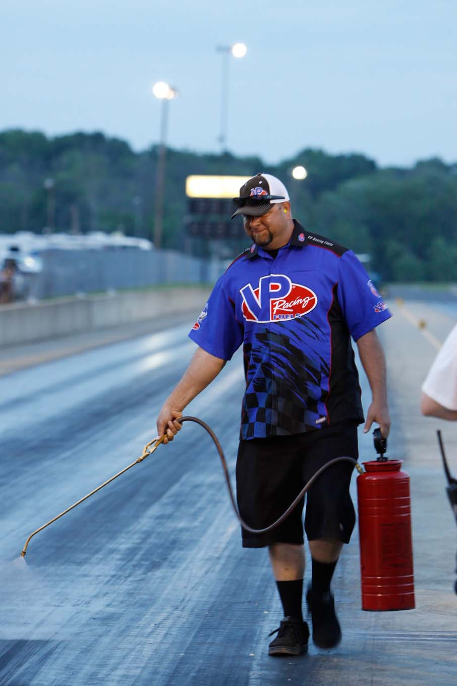 Traction guru Jason Rueckert hand-sprays the starting-line area during Prize Fight 2 at Ohio Valley Raceway in June 2015.