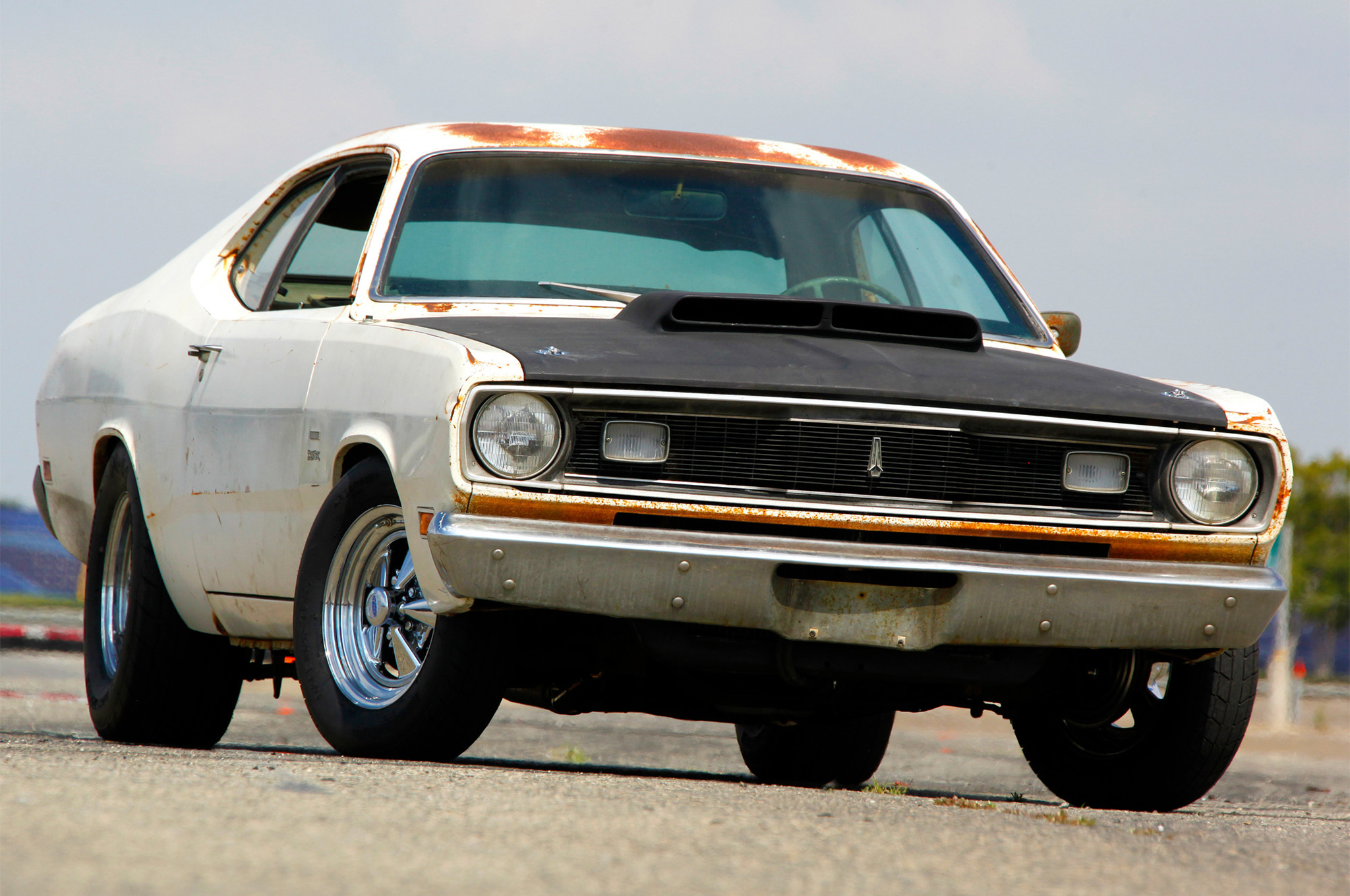 The Crop Duster is a 1970 Plymouth, the first model year of the Valiant Duster. Most of the paint is the original EW1-code Alpine White.