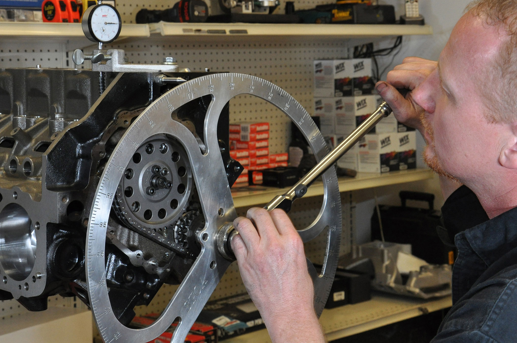 Kevin Stoa, a contributor to this story, adjusts the cam timing on one of the race motor's KS Engineering builds.