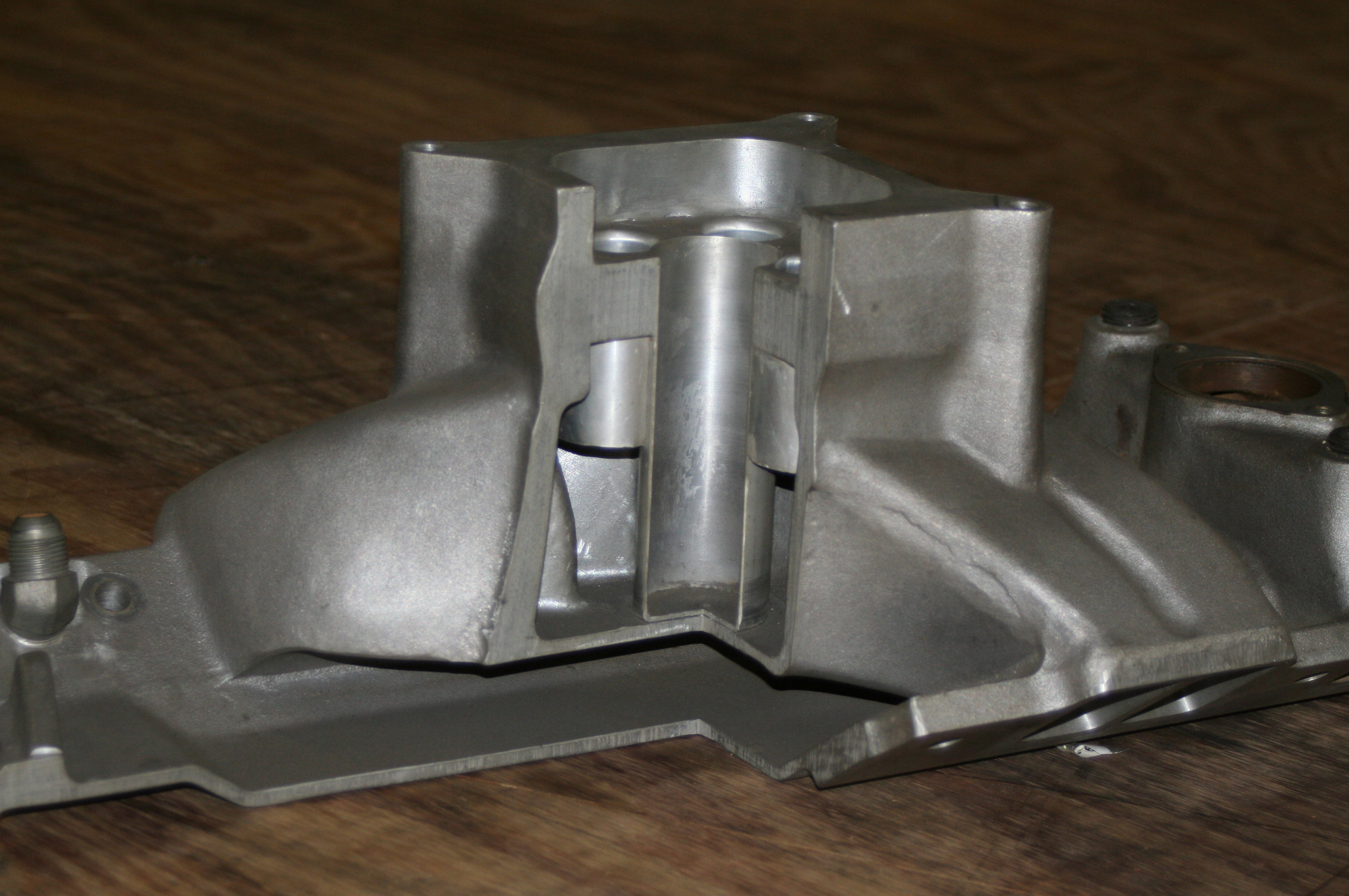 Keith Dorton's restrictor plate intake manifold was something of legend in the '90s and beyond. This cutaway shows some of the genius behind it.