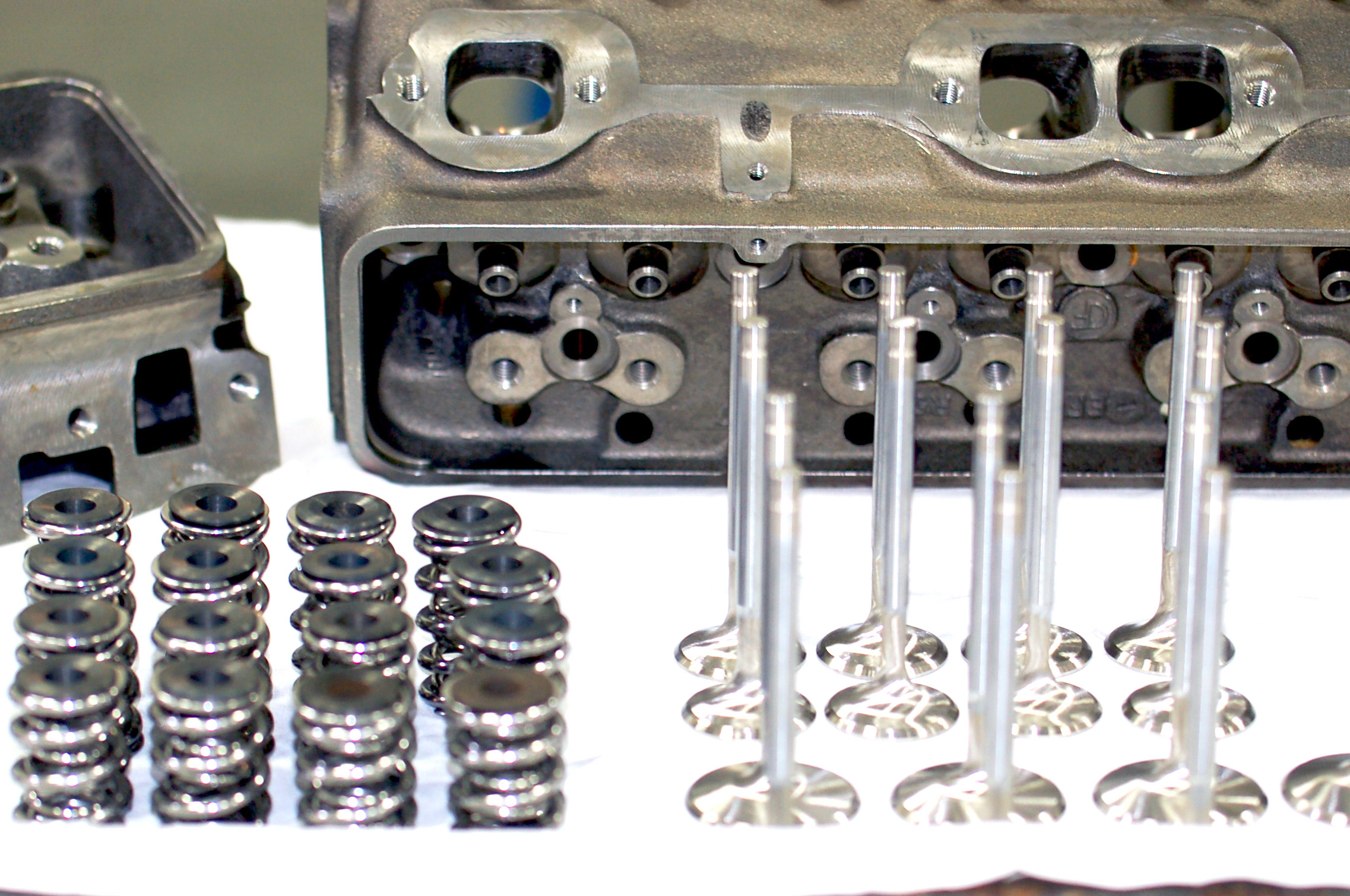 When you disassemble your motor for a rebuild, it is a good time to check the clearances when the valve is at full compression, or full lift, and the seat pressure or load at the same height. Record the spring length at full open position for each valvespring and re-create those heights on the valvespring rater.
