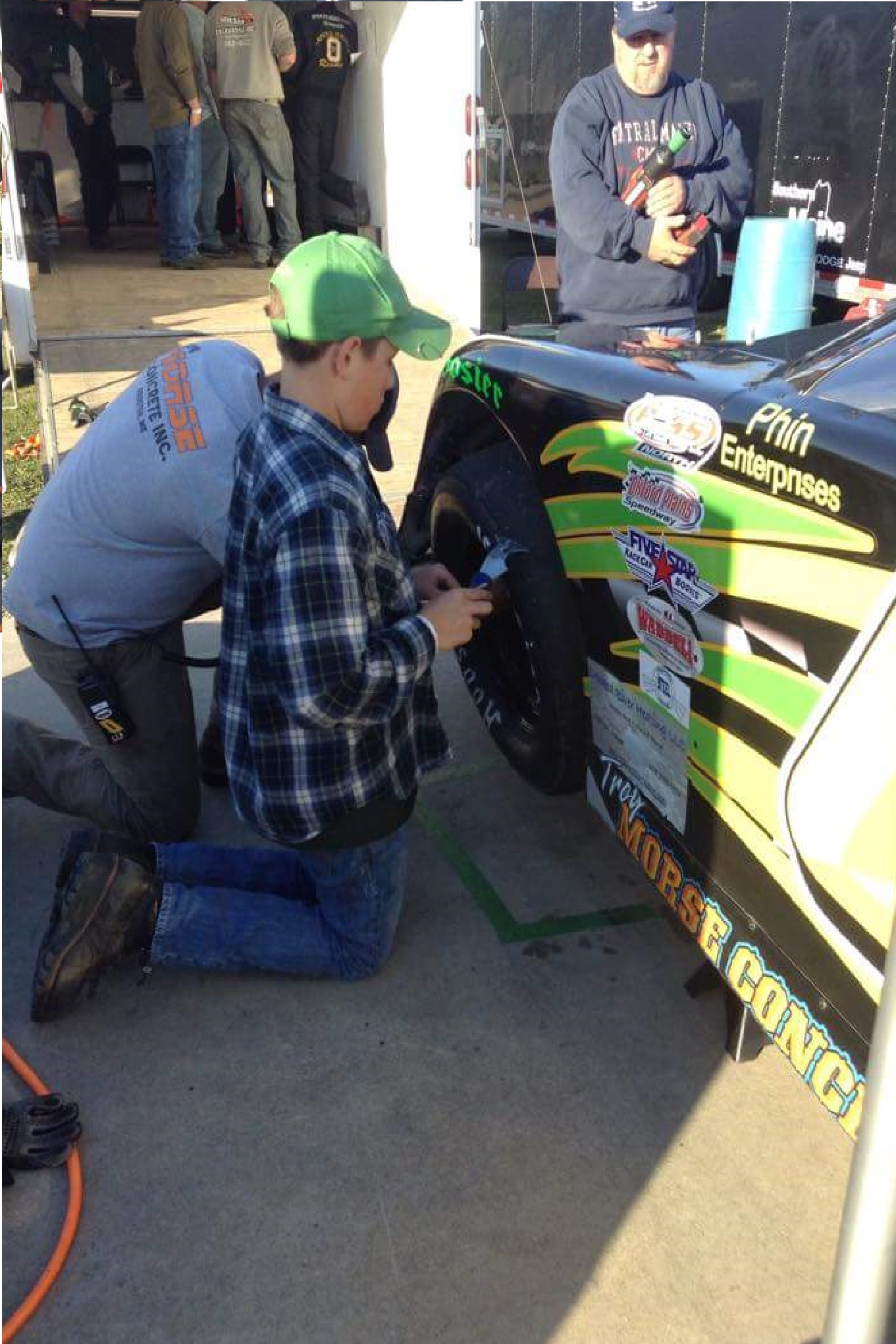 The students from Oxford Plains Middle School aren't afraid to get their hands dirty on the Aspire Higher Race Car at Oxford Plains Speedway.