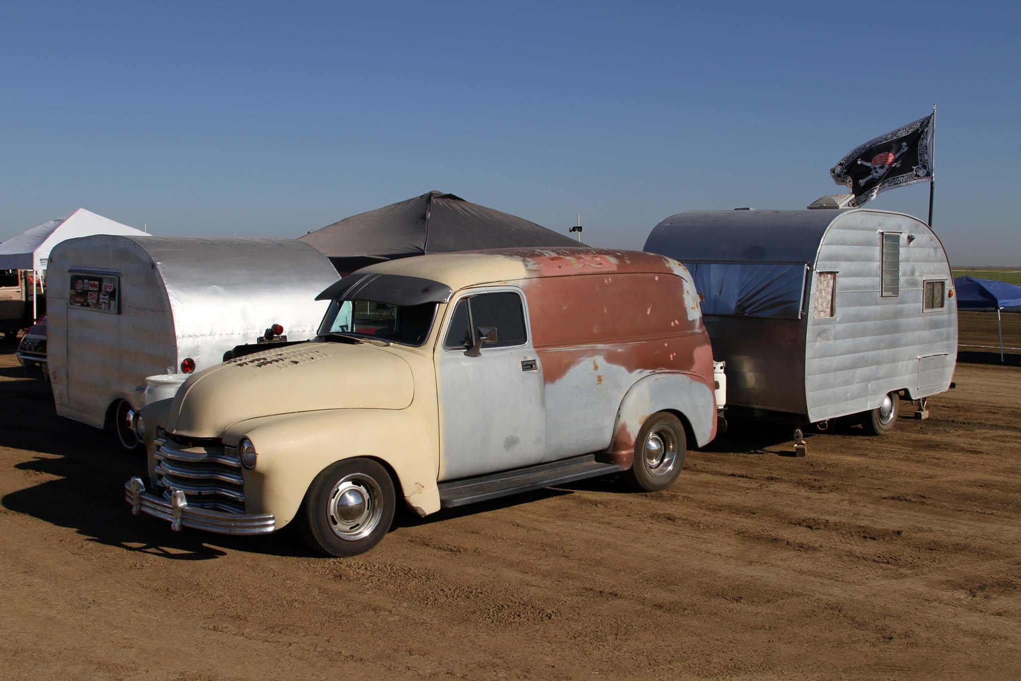 Most of the racers and some spectators camp out at Eagle Field. There are some who take it to the next level by bringing out their vintage travel trailers and tow rigs to camp in. The vintage campers get priority parking in the car show.