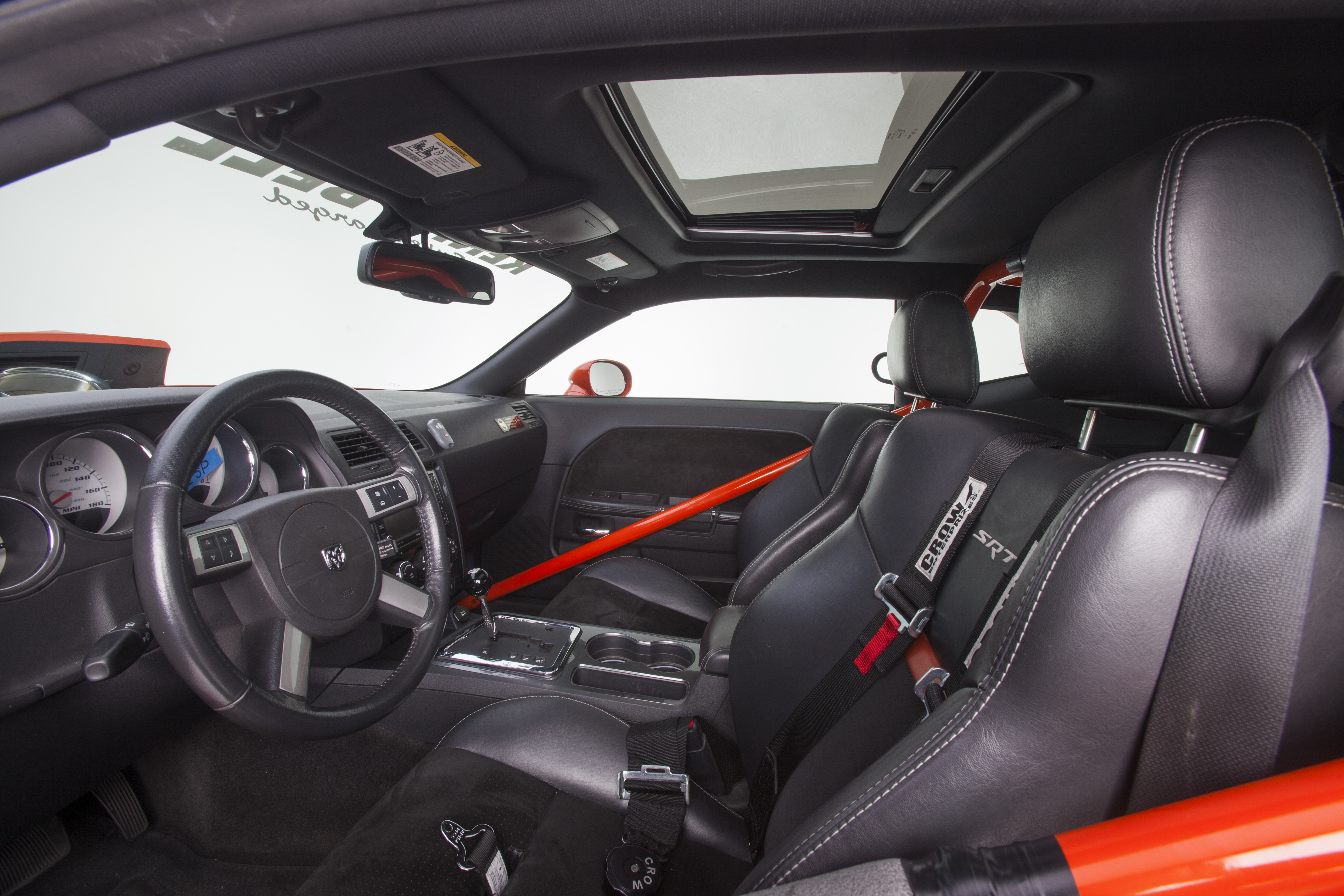 Other than the racing harnesses and a rollbar, the Challenger's interior is alarmingly stock. Most race cars that are half as fast have interiors that are twice as ugly.