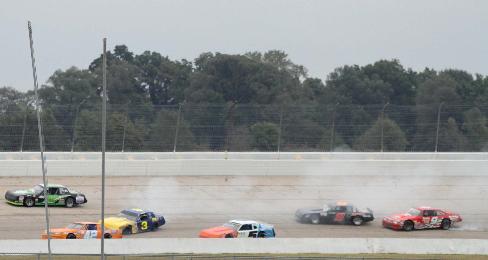 Cars scramble to avoid the spin.